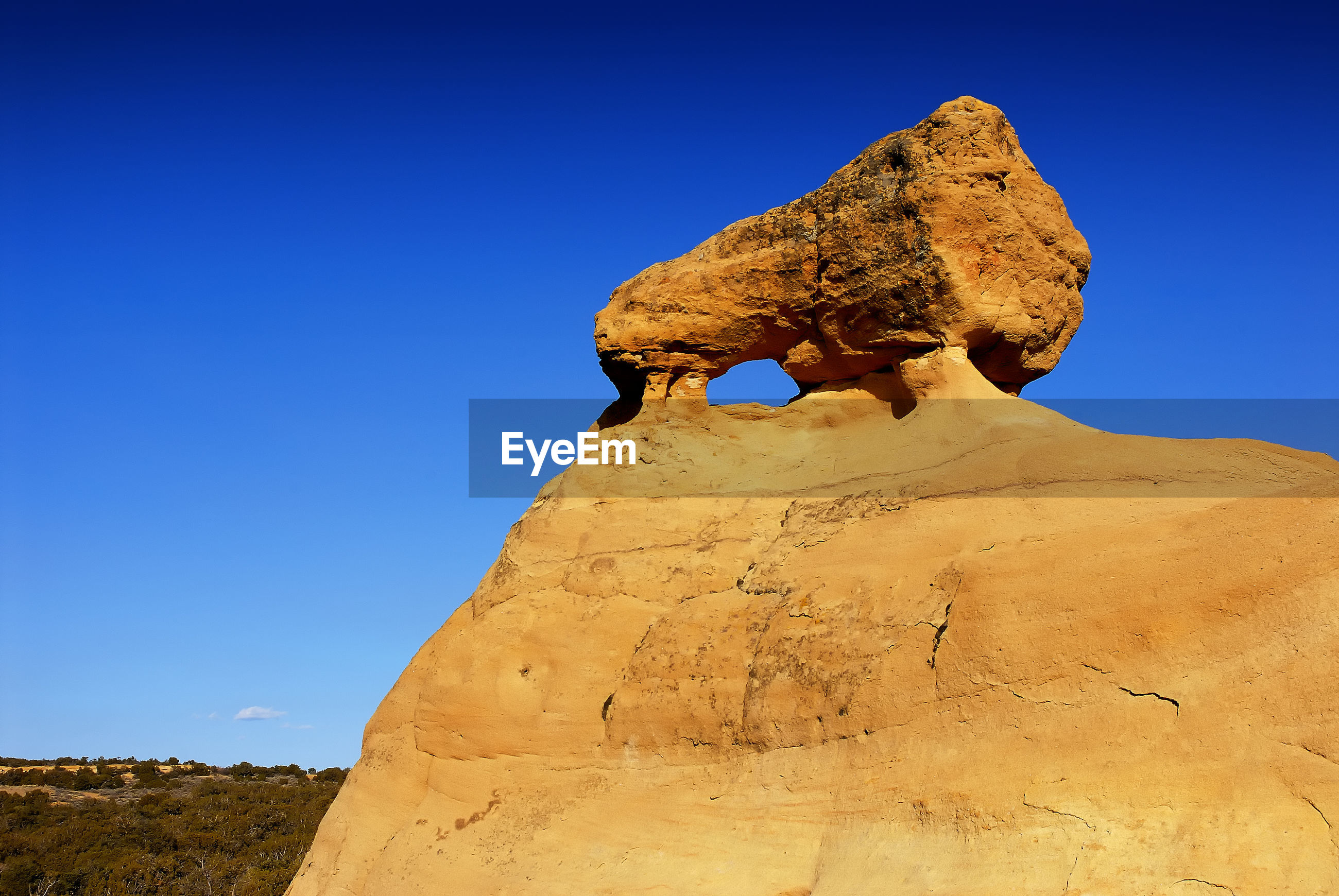 View of huge rocky structure against clear sky