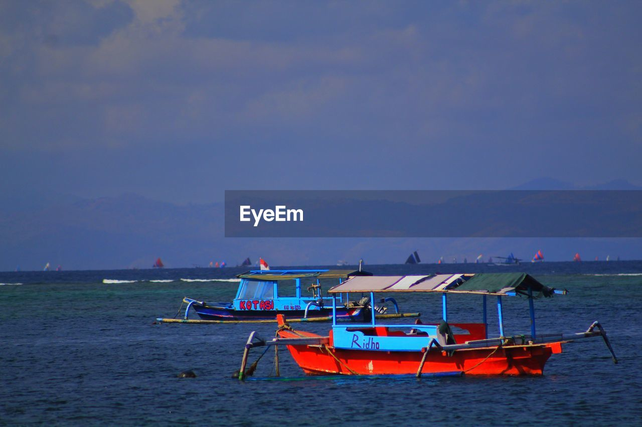 nautical vessel, transportation, mode of transportation, water, sky, sea, scenics - nature, moored, beauty in nature, nature, waterfront, tranquility, no people, mountain, tranquil scene, outdoors, cloud - sky, day, non-urban scene, fishing boat, fishing industry, anchored