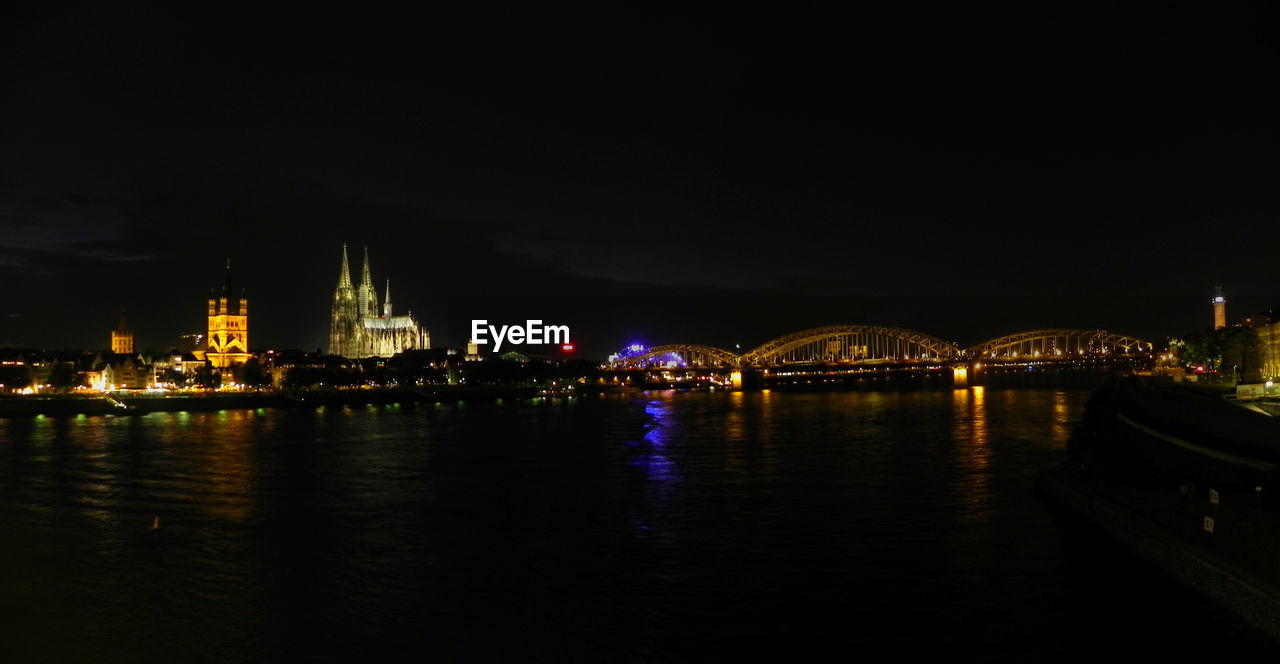 architecture, illuminated, built structure, night, water, river, bridge - man made structure, connection, travel destinations, waterfront, building exterior, no people, outdoors, sky, city, chain bridge
