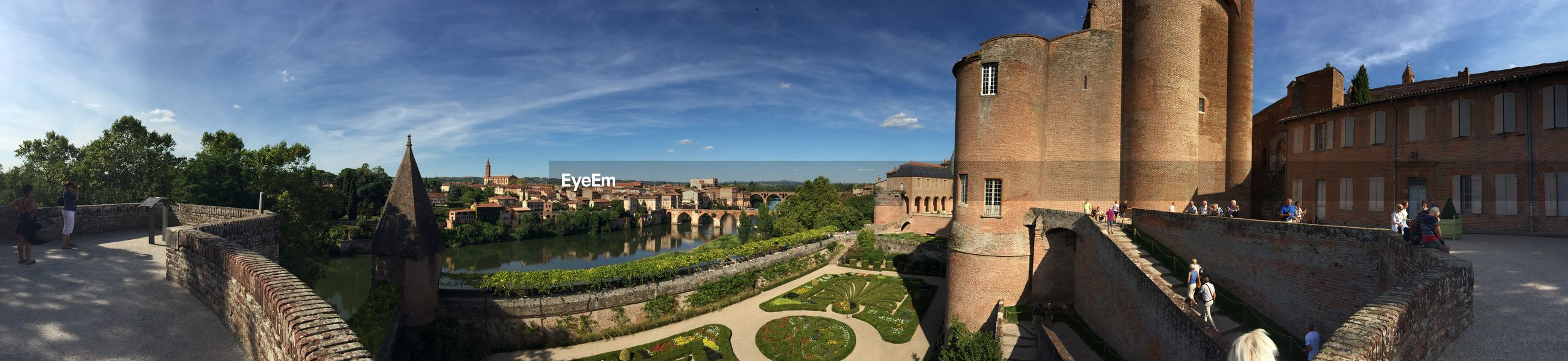 Panoramic view of musee toulouse-lautrec and field against sky