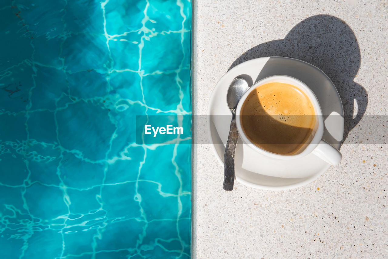 High angle view of coffee by poolside