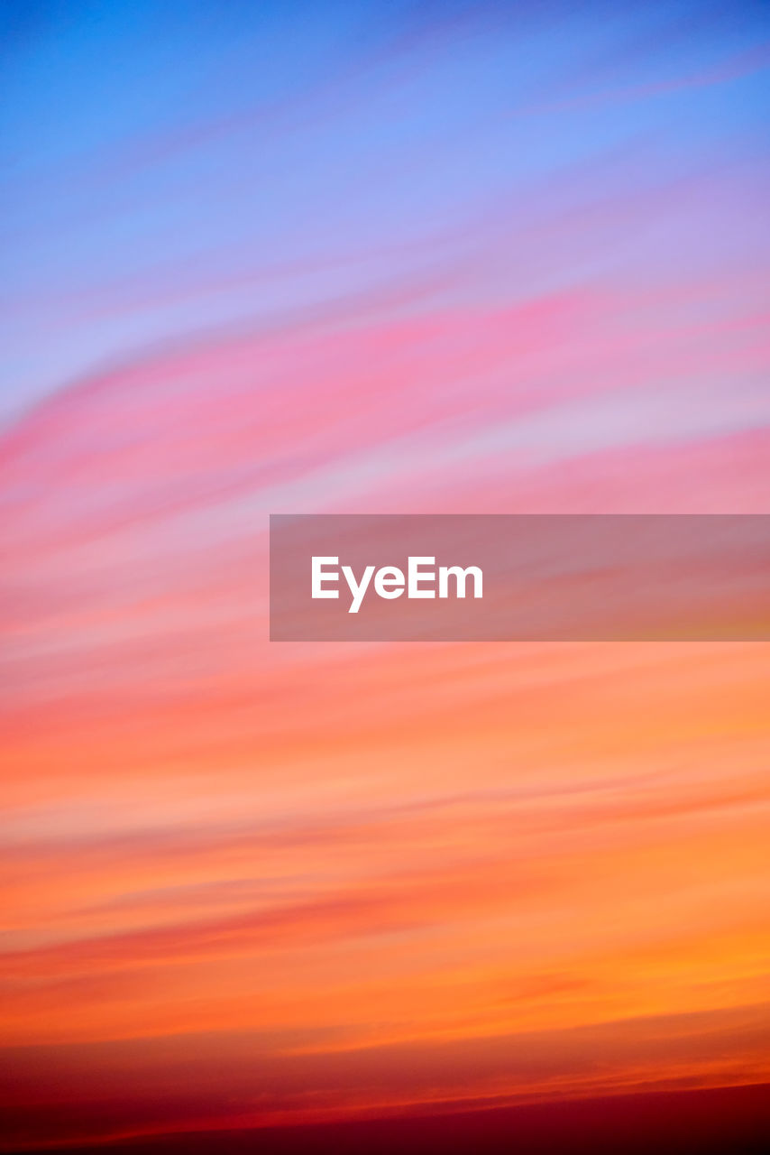 sunset, orange color, backgrounds, sky, no people, scenics - nature, beauty in nature, nature, tranquility, full frame, abstract, tranquil scene, multi colored, defocused, outdoors, cloud - sky, copy space, pink color, idyllic, vibrant color, romantic sky