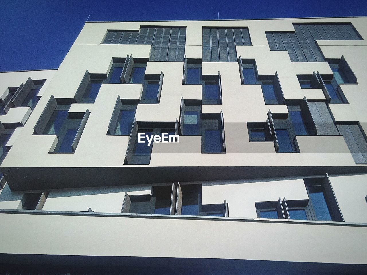 architecture, building exterior, built structure, low angle view, window, outdoors, no people, blue, day, modern, city, close-up, sky
