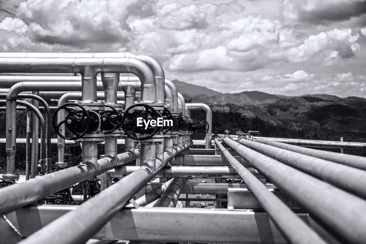 metal, cloud - sky, sky, pipe - tube, day, industry, no people, pipeline, nature, mountain, outdoors, transportation, connection, fuel and power generation, mode of transportation, technology, in a row, close-up, rail transportation, equipment, industrial equipment