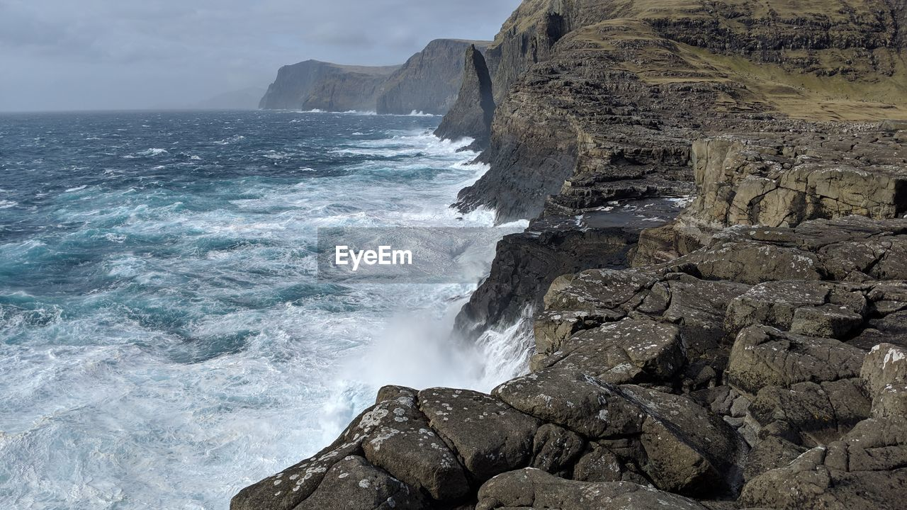sea, water, beauty in nature, rock, solid, rock - object, scenics - nature, motion, sky, nature, rock formation, land, no people, tranquil scene, wave, day, aquatic sport, sport, outdoors, horizon over water, power in nature, rocky coastline, breaking, eroded