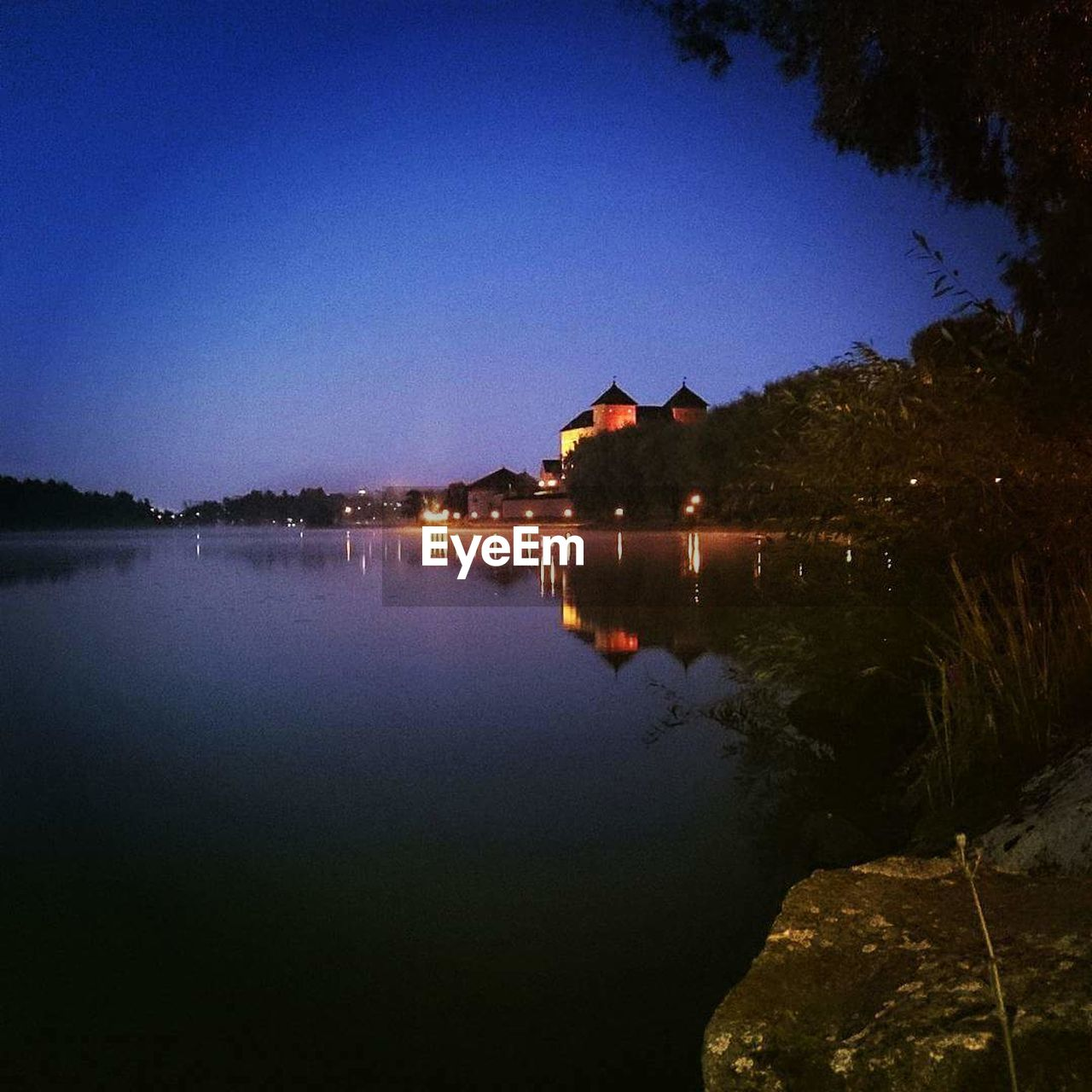 water, reflection, outdoors, no people, lake, built structure, night, architecture, nature, sky, tranquil scene, tranquility, scenics, blue, building exterior, illuminated, beauty in nature
