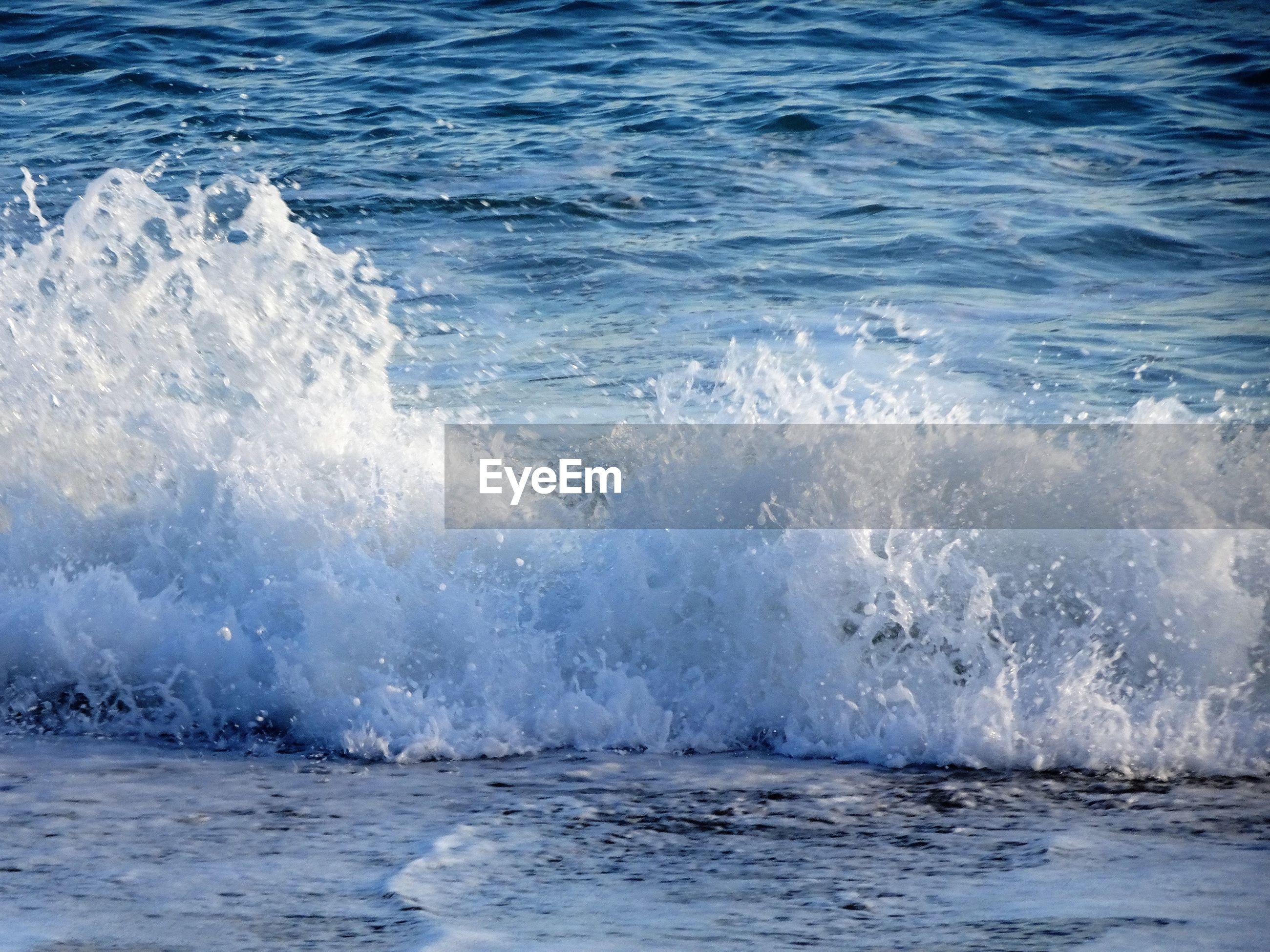 WAVE SPLASHING ON SEA