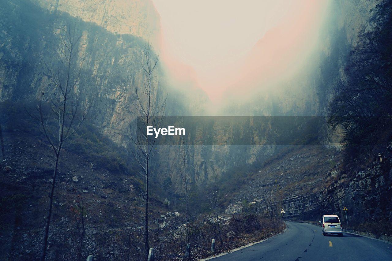 Empty road passing through mountain landscape
