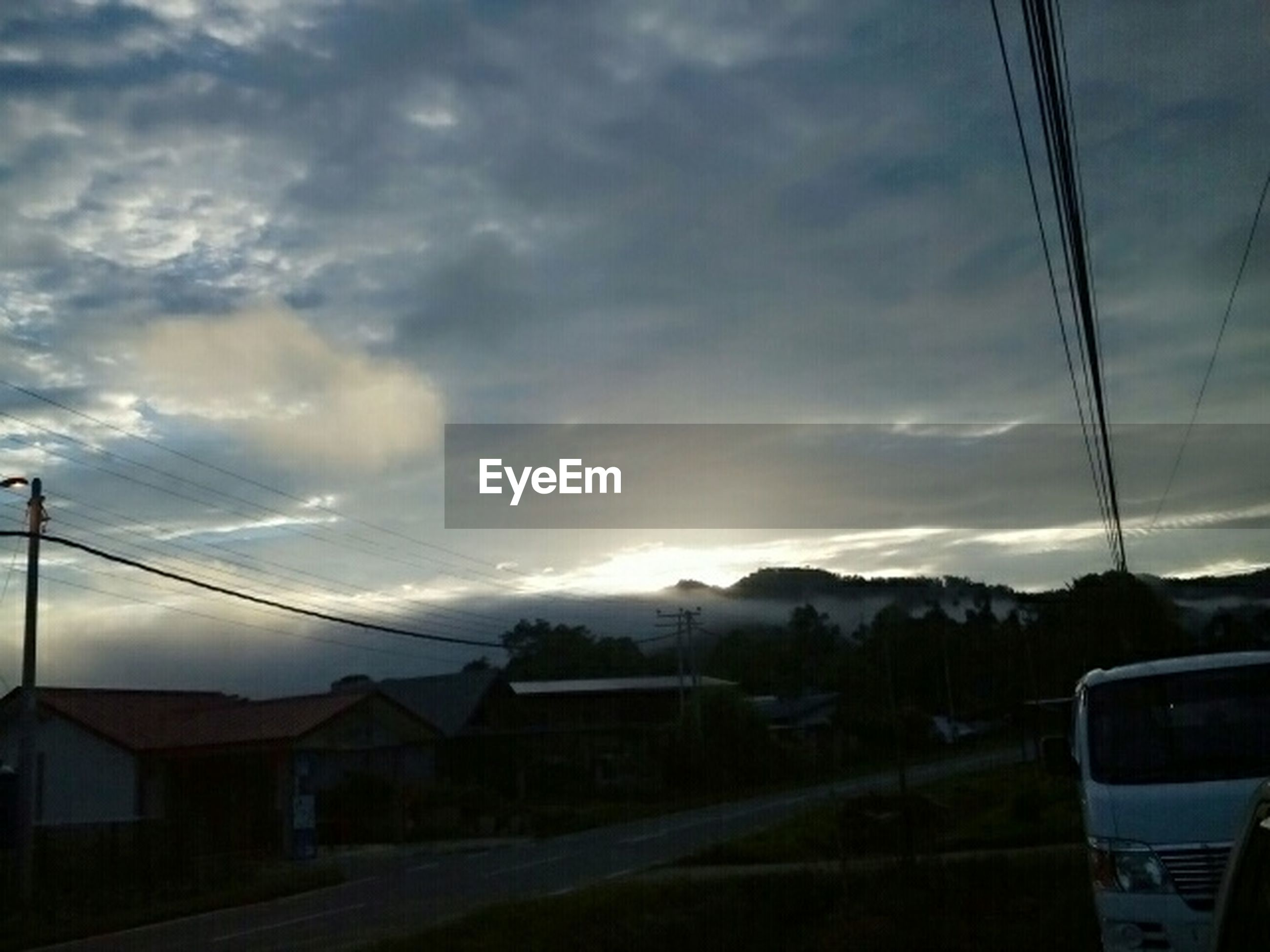sky, mountain, cloud - sky, sunset, landscape, cloud, road, scenics, transportation, beauty in nature, mountain range, cloudy, nature, house, tranquil scene, tranquility, electricity pylon, silhouette, power line, dusk