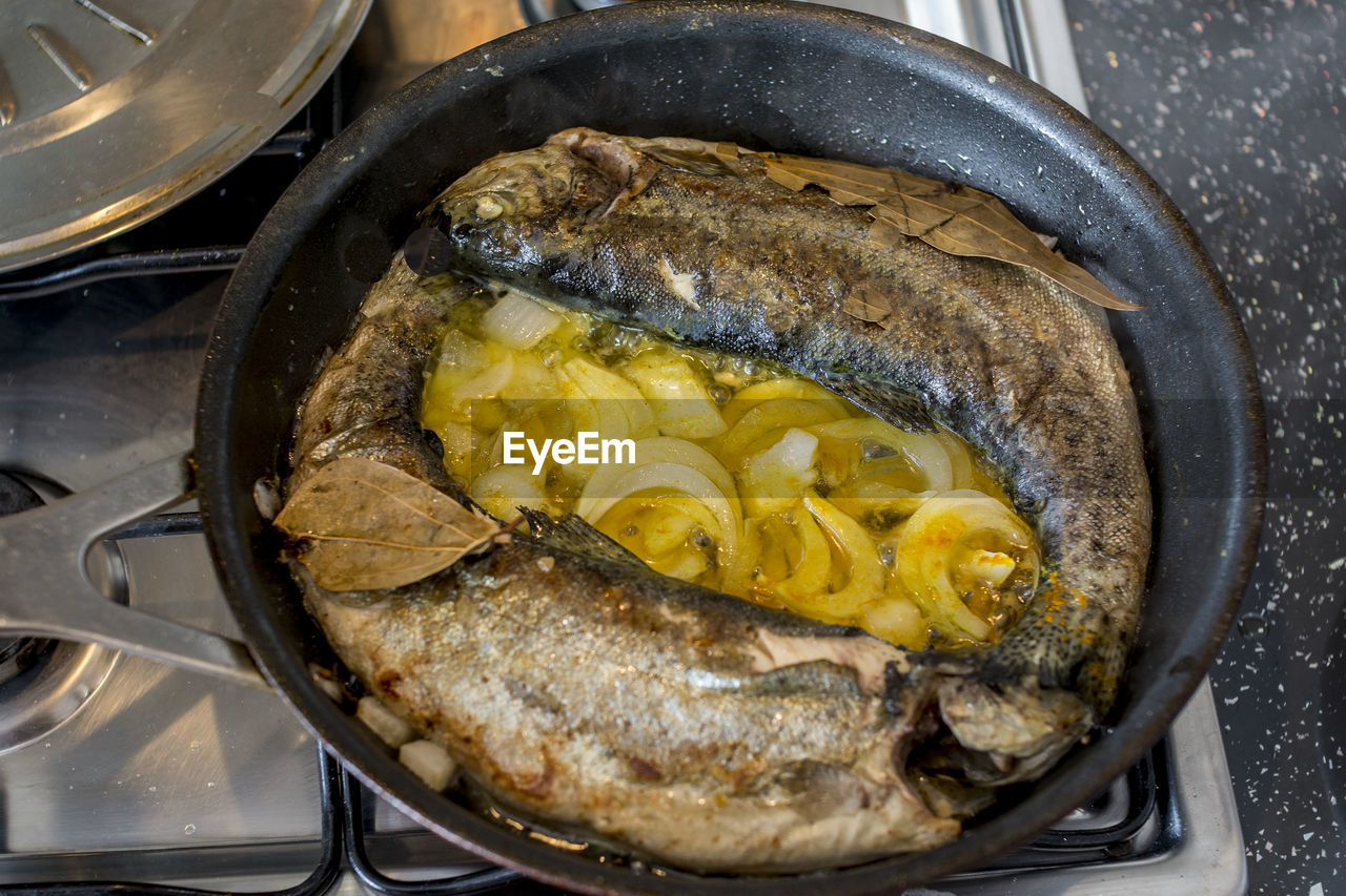 High Angle View Of Fish In Skillet