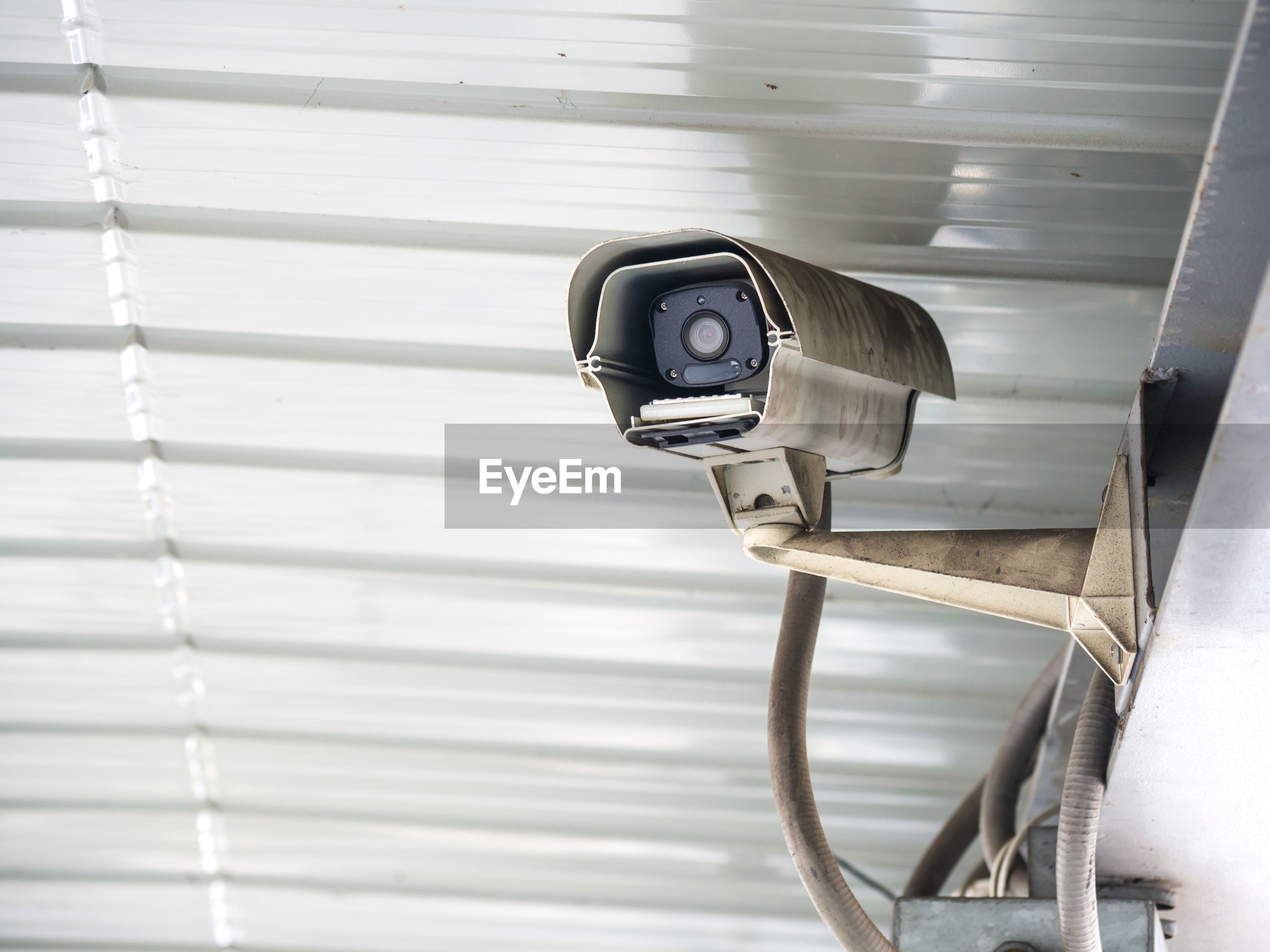 Low angle view of security camera on roof