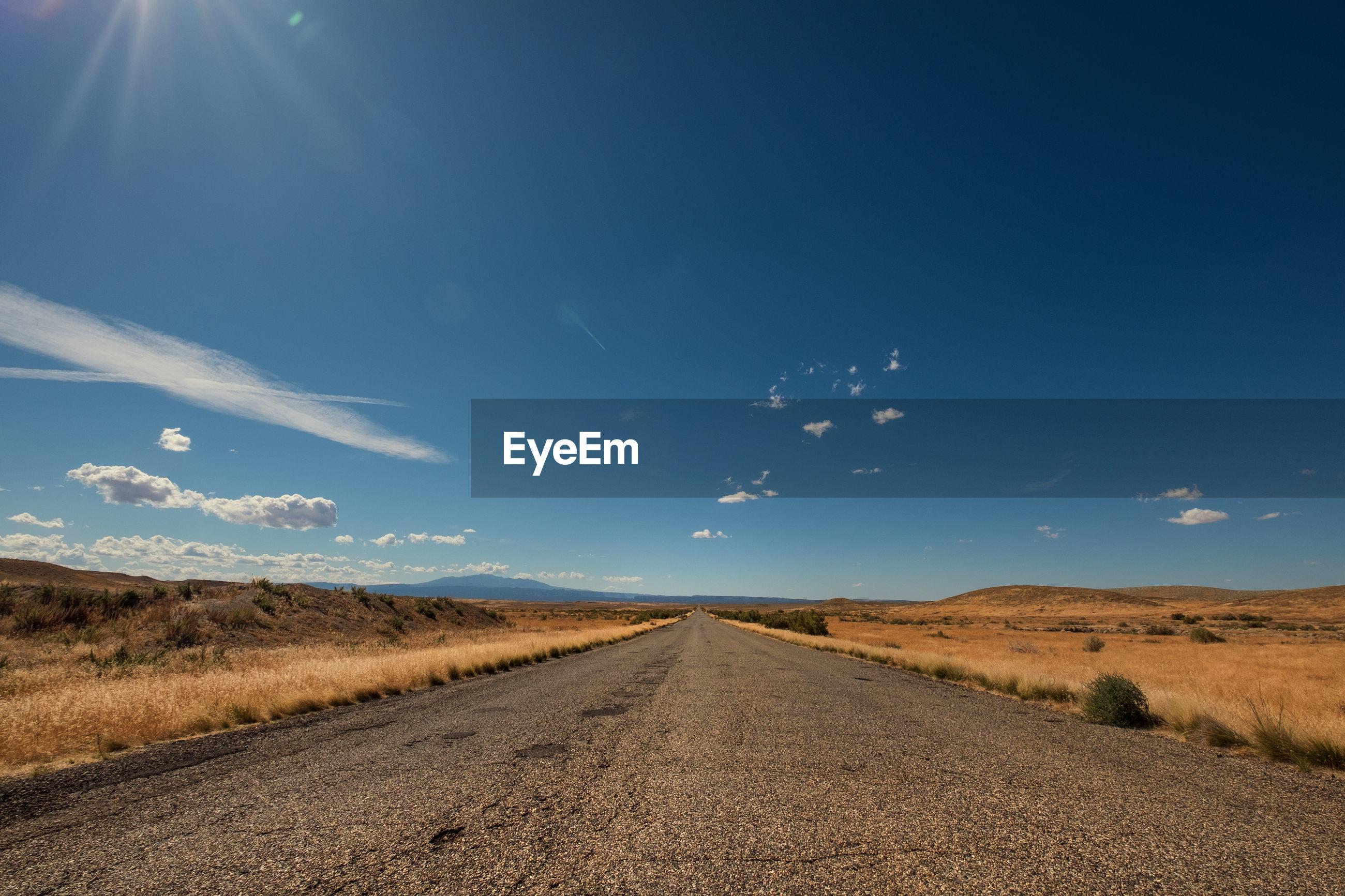 Deserted road in arid landscape