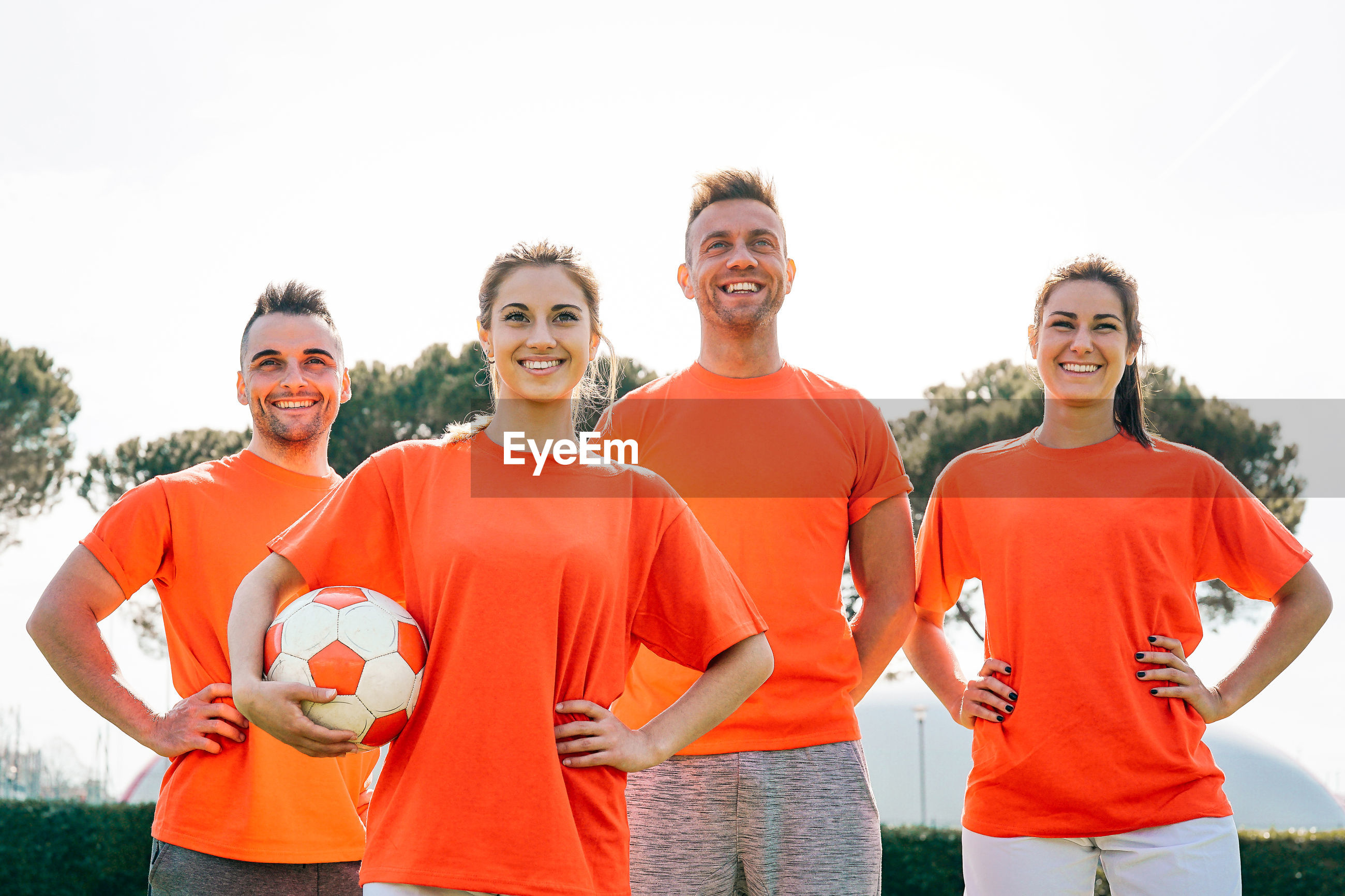 Smiling soccer players standing