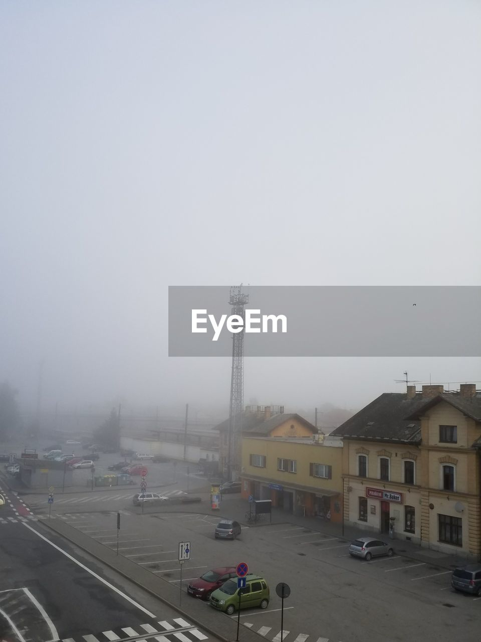 architecture, car, transportation, built structure, fog, city, building exterior, land vehicle, no people, outdoors, day, sky