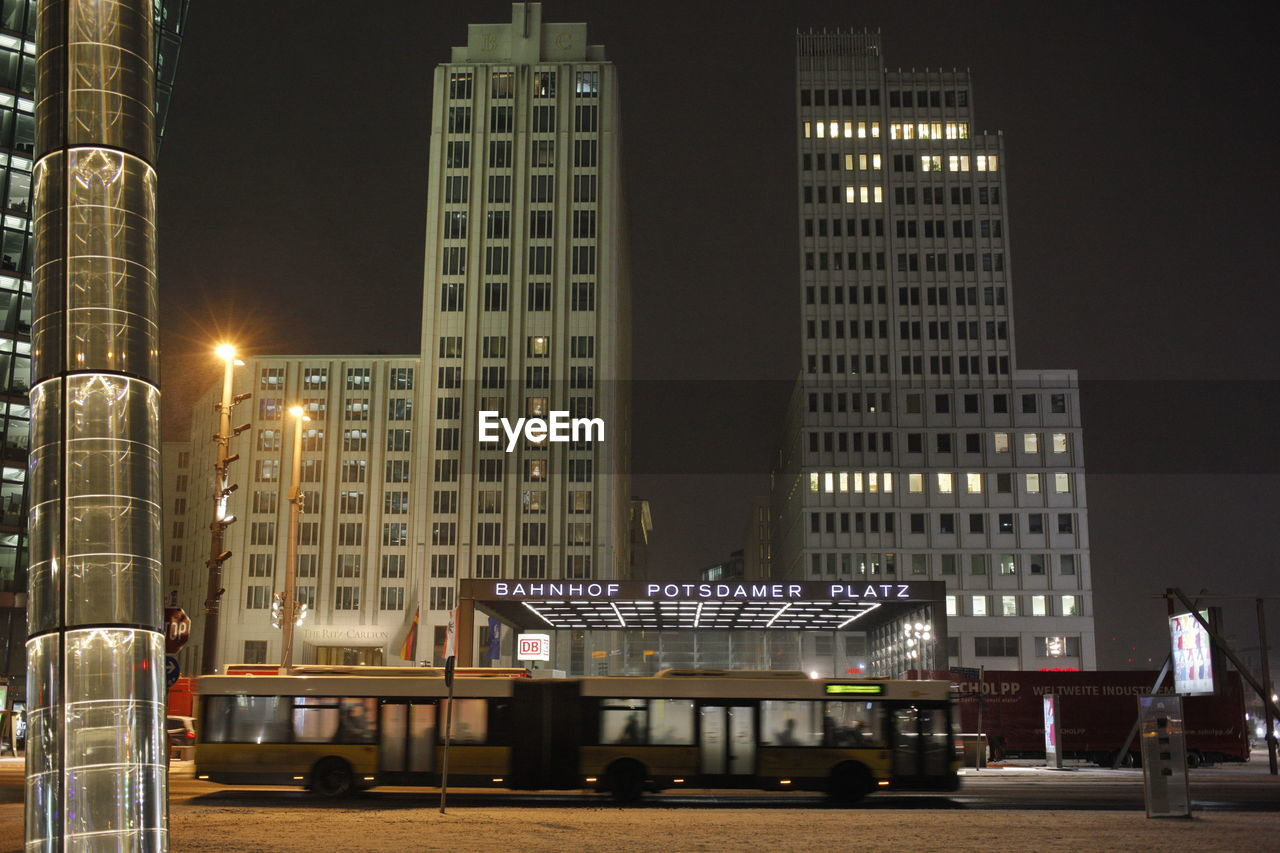building exterior, illuminated, architecture, built structure, night, city, building, street, office building exterior, lighting equipment, street light, skyscraper, nature, sky, office, city life, seat, tall - high, outdoors, real people