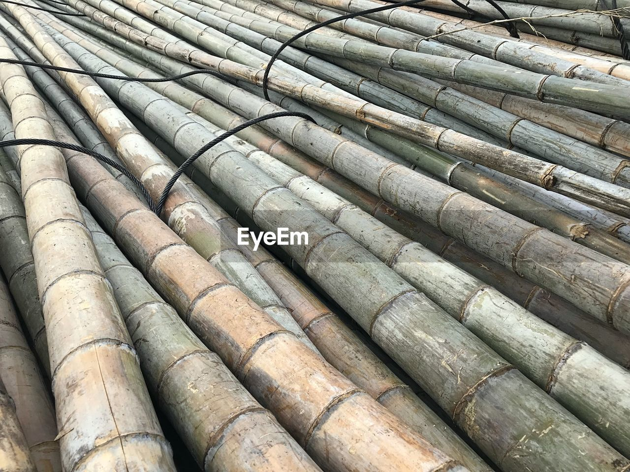 full frame, backgrounds, no people, pipe - tube, day, pattern, large group of objects, side by side, high angle view, close-up, outdoors, in a row, detail, repetition, abundance, roof, bamboo - material, stack, nature, sunlight, roof tile, bamboo - plant