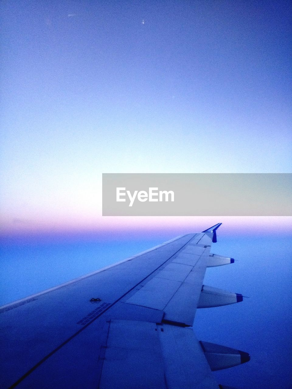 airplane, transportation, airplane wing, air vehicle, journey, no people, blue, mode of transport, aircraft wing, flying, sky, nature, travel, outdoors, clear sky, day, scenics, sunset, beauty in nature, water, close-up