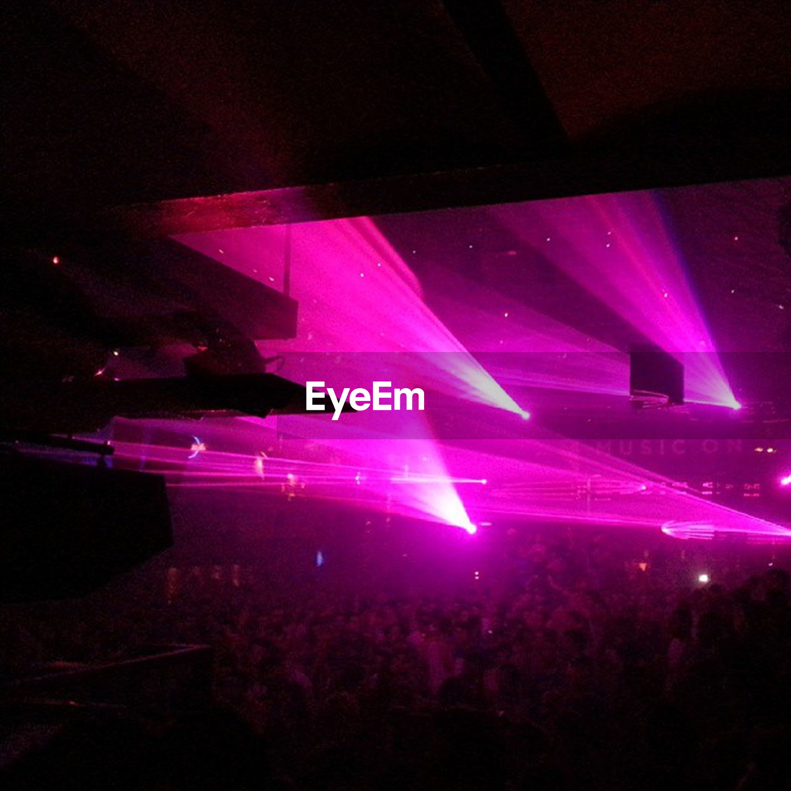 illuminated, night, nightlife, light - natural phenomenon, arts culture and entertainment, large group of people, event, crowd, lighting equipment, glowing, light beam, nightclub, celebration, music, dark, person, multi colored, light, enjoyment, indoors