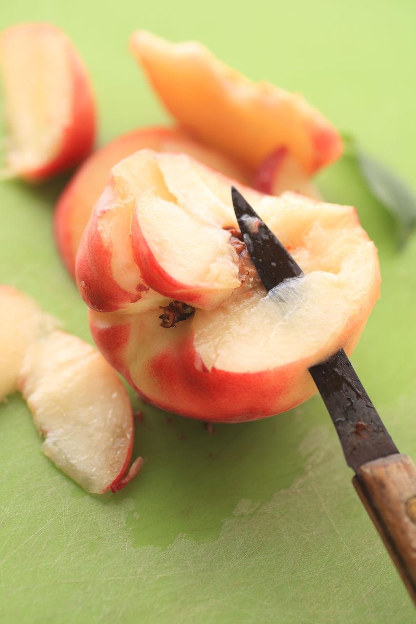 Knife in peach on cutting board