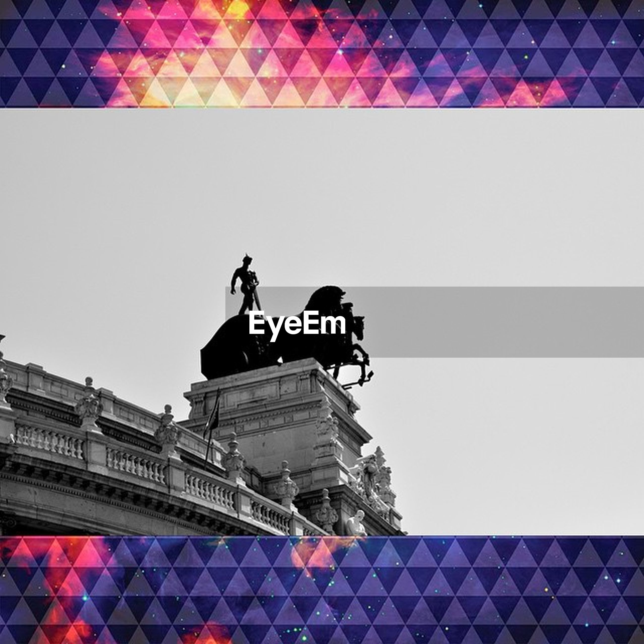 statue, human representation, sculpture, art and craft, low angle view, architecture, built structure, art, creativity, famous place, building exterior, clear sky, travel, international landmark, travel destinations, capital cities, history, tourism