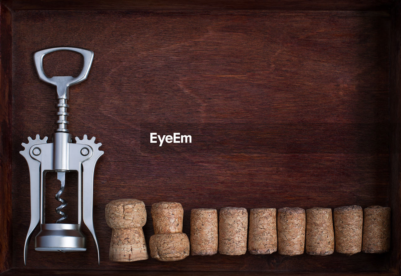 Directly Above Shot Of Corkscrew With Corks On Table