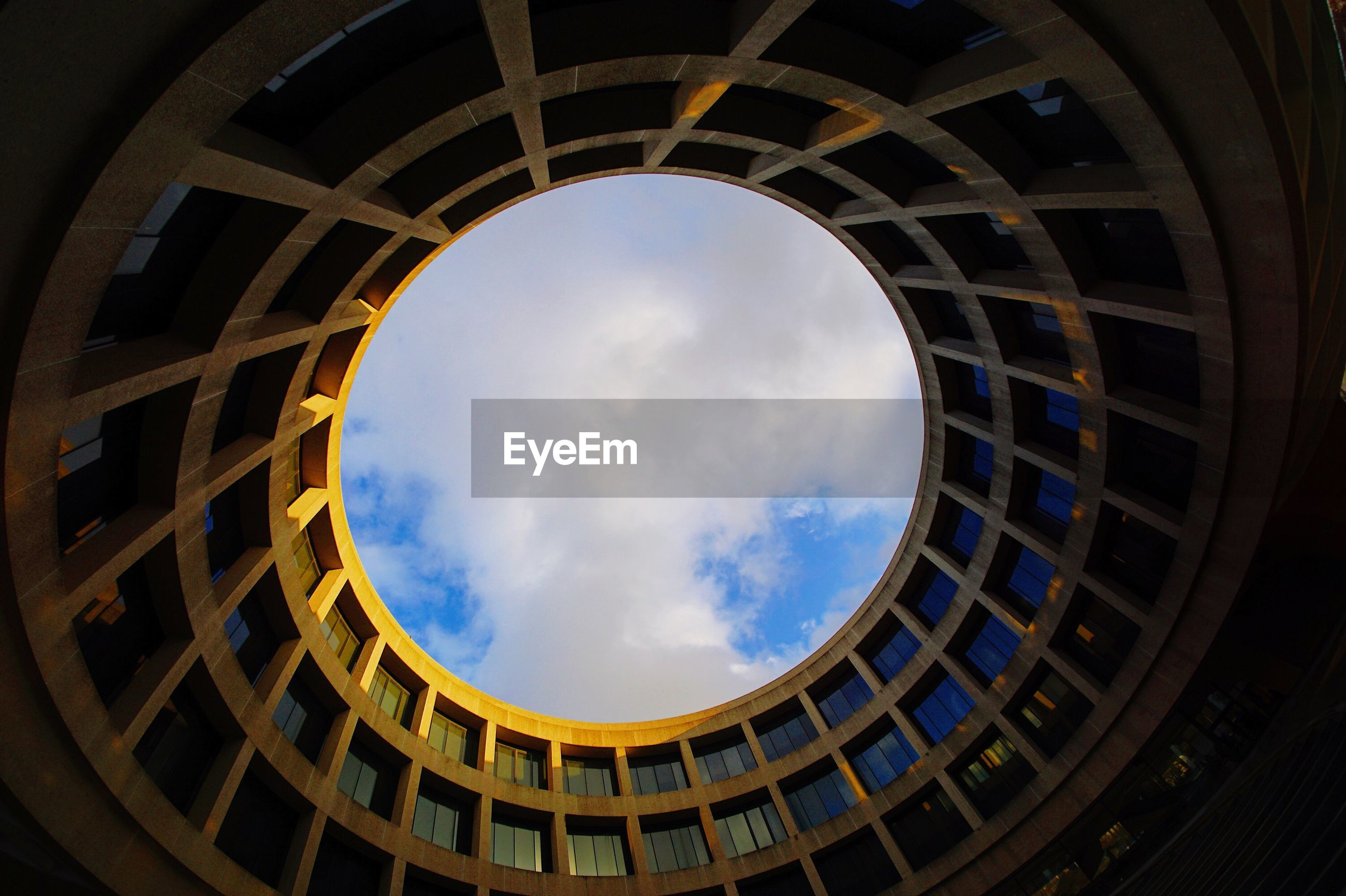Directly below shot of hirshhorn museum and sculpture garden against sky