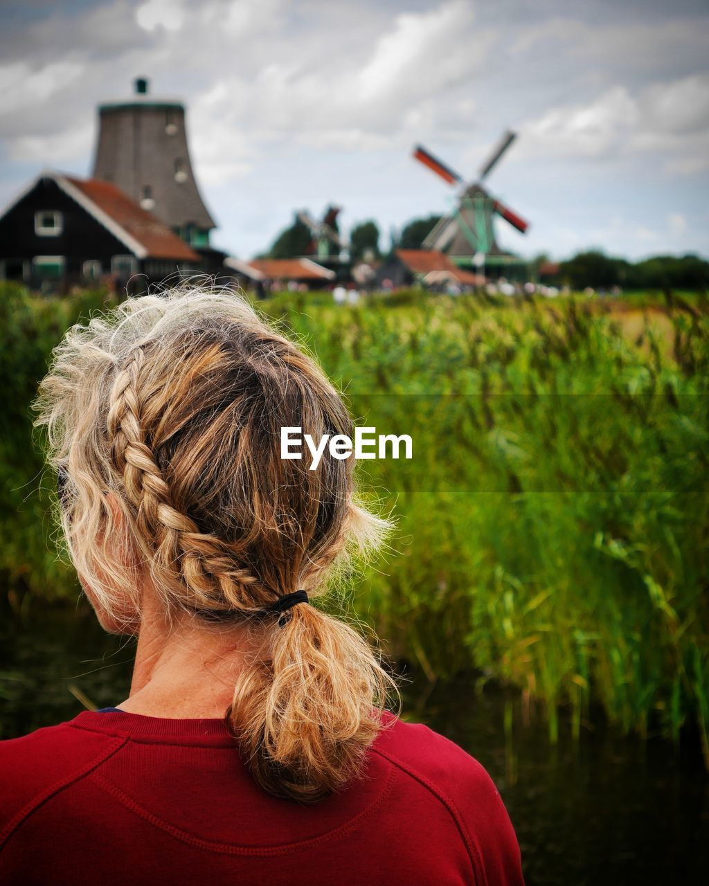Rear View Of Woman Standing On Farm