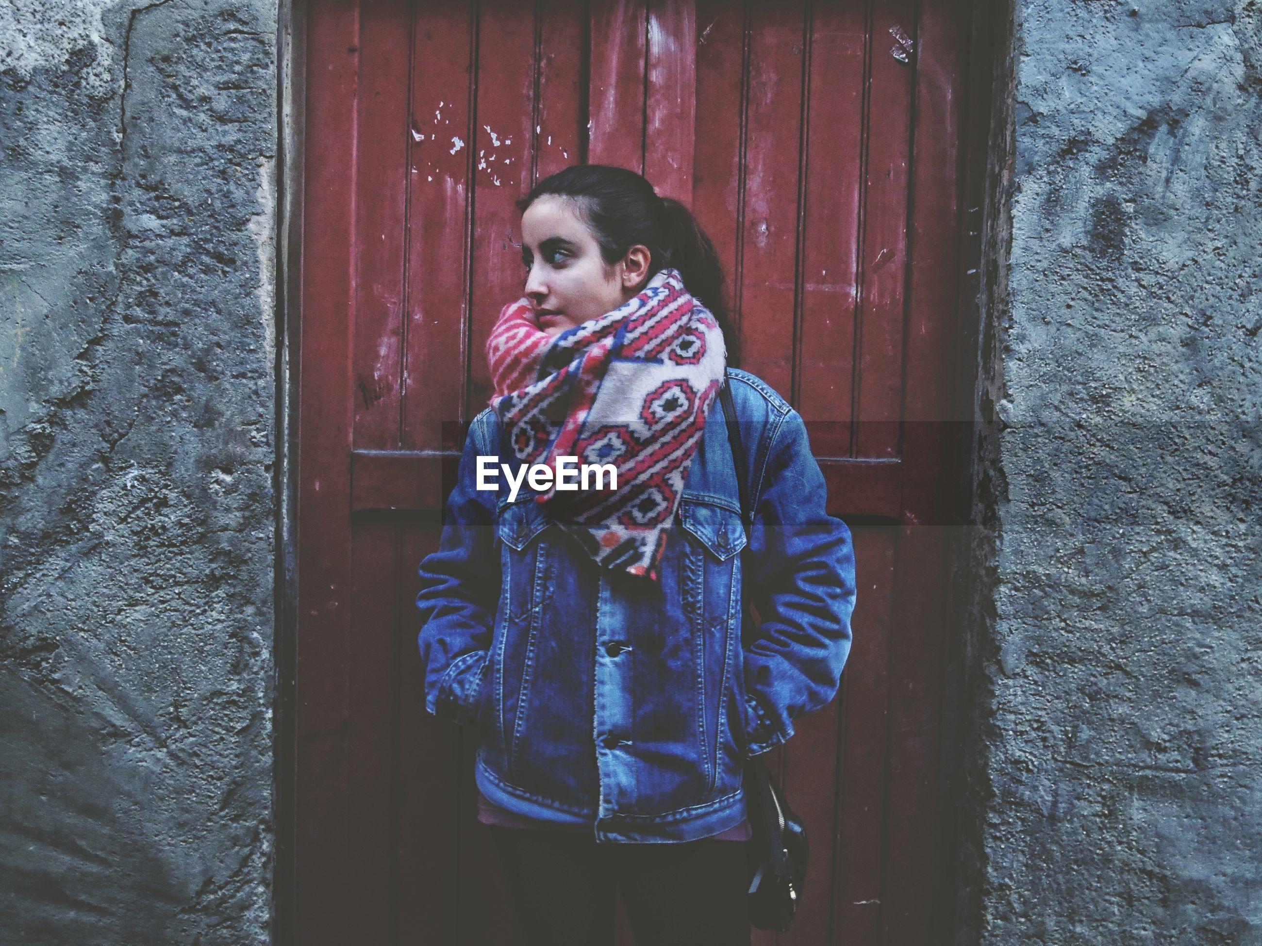 Woman wearing denim jacket