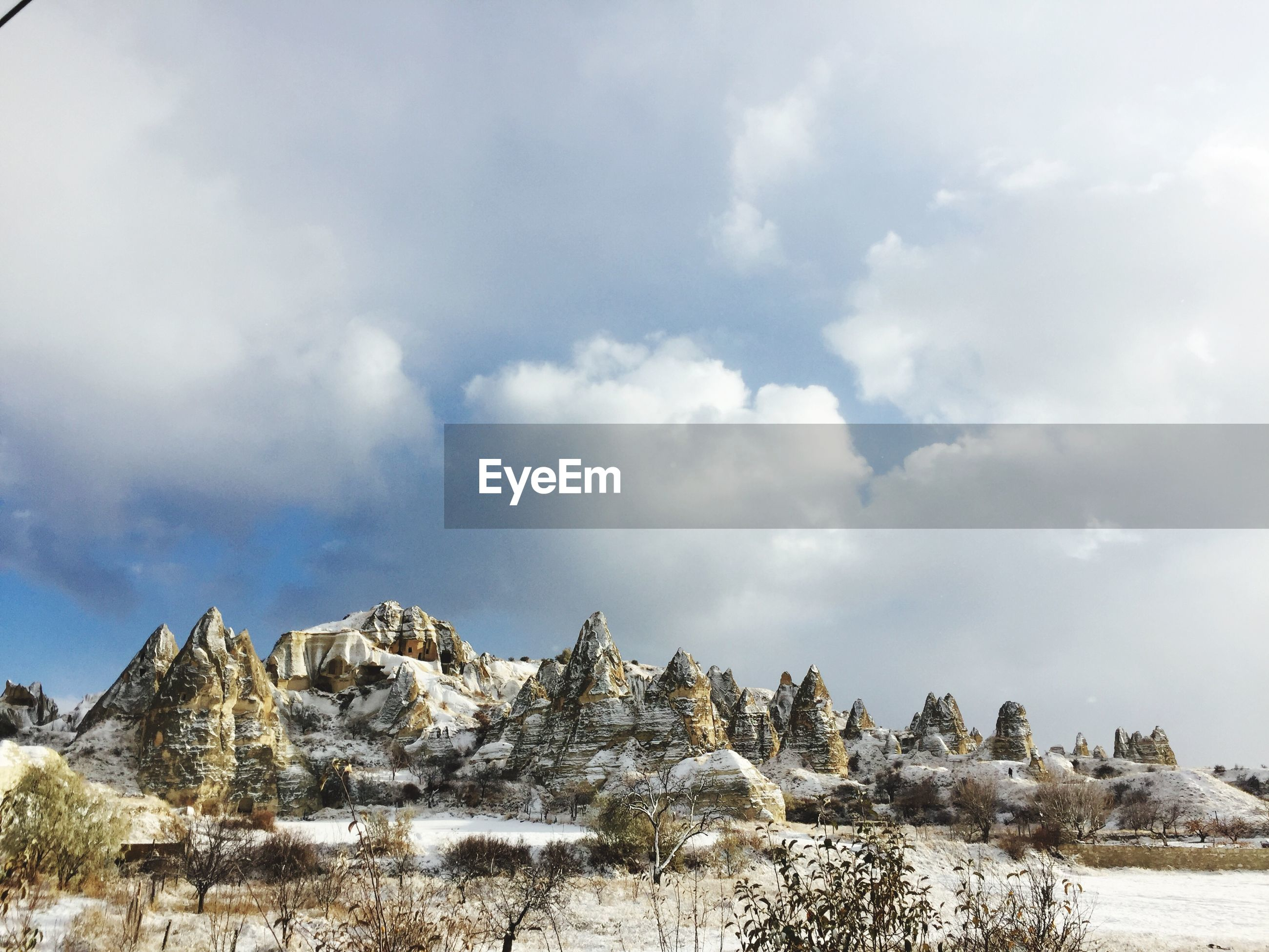Rock formations against sky at cappadocia during winter