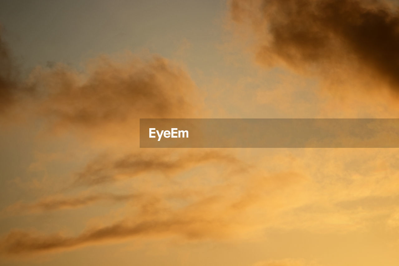 cloud - sky, sky, beauty in nature, sunset, scenics - nature, tranquility, low angle view, orange color, tranquil scene, nature, no people, idyllic, backgrounds, outdoors, full frame, dramatic sky, cloudscape, dusk, majestic, meteorology