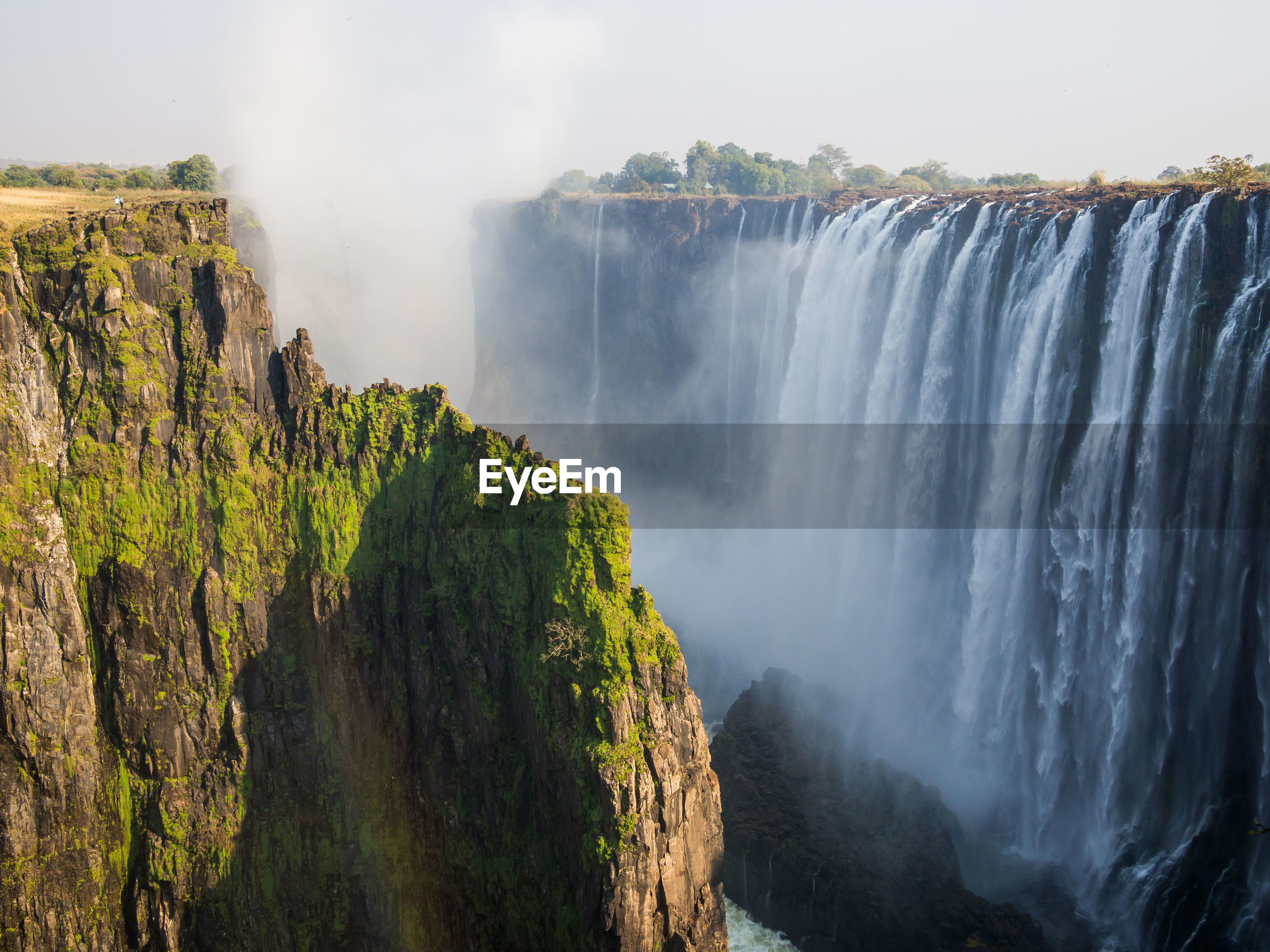Scenic view of victoria falls waterfall at border between zambia and zimbabwe