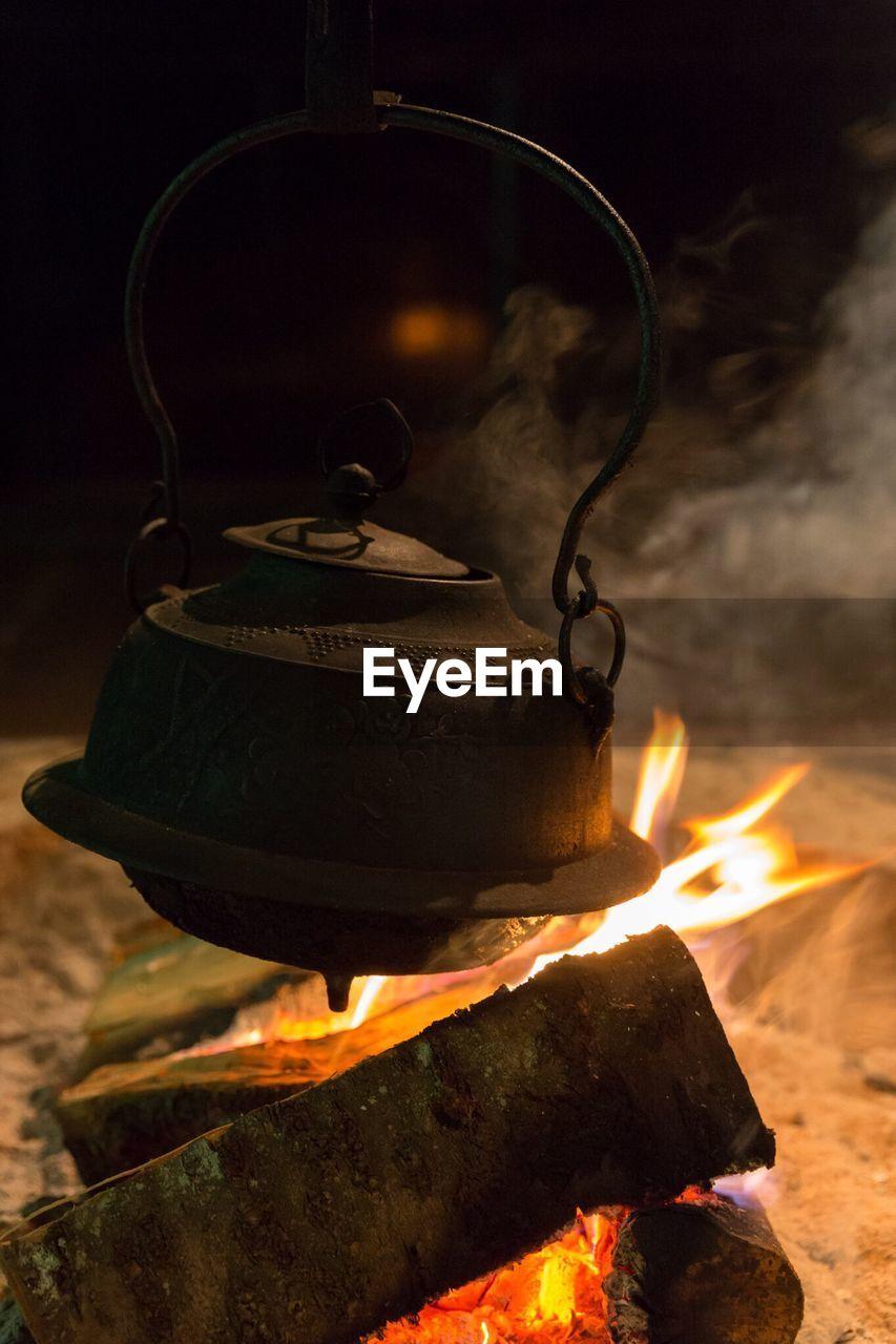 Tea Boiling In Kettle Over Bonfire
