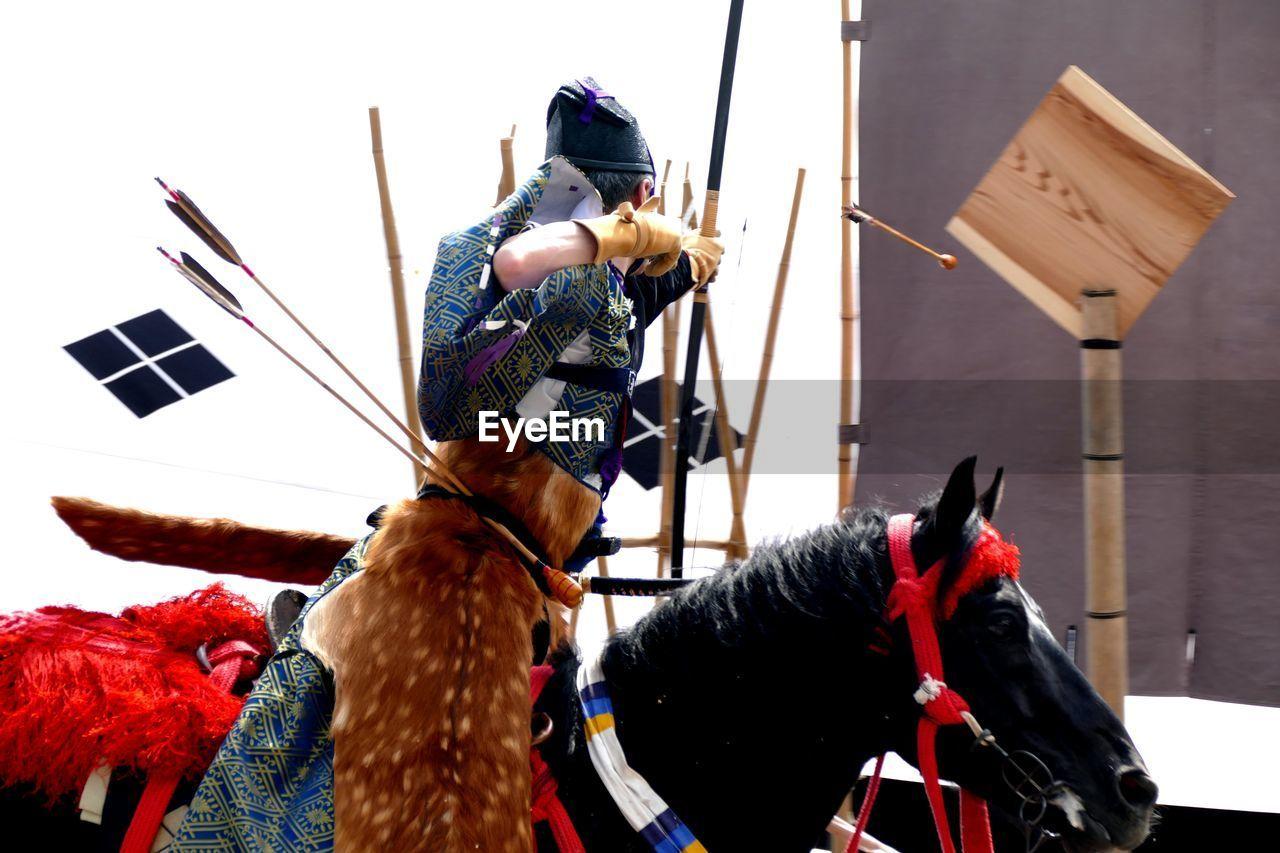 Samurai Aiming While Sitting On Horse