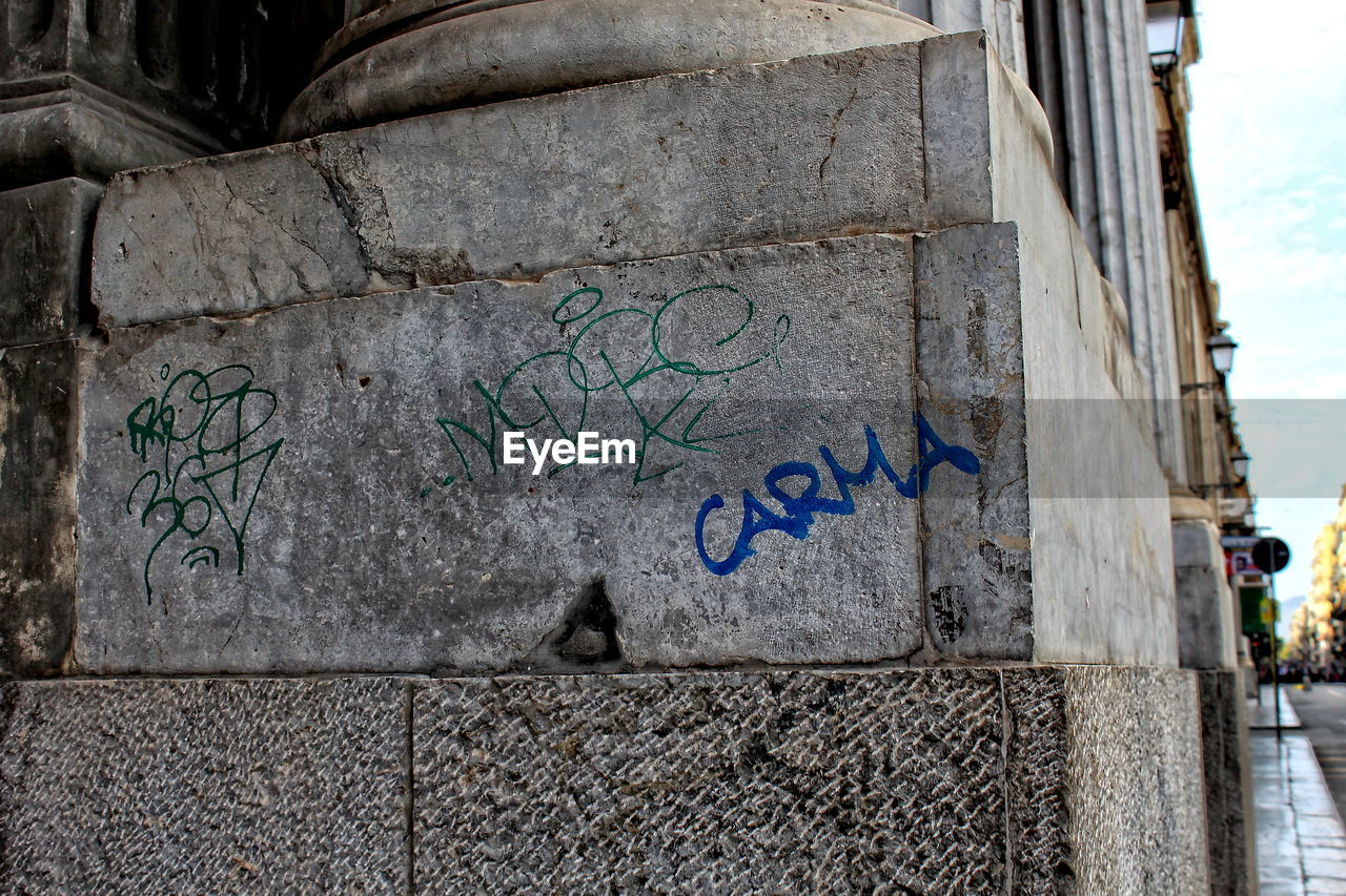 built structure, architecture, day, graffiti, outdoors, building exterior, no people, close-up