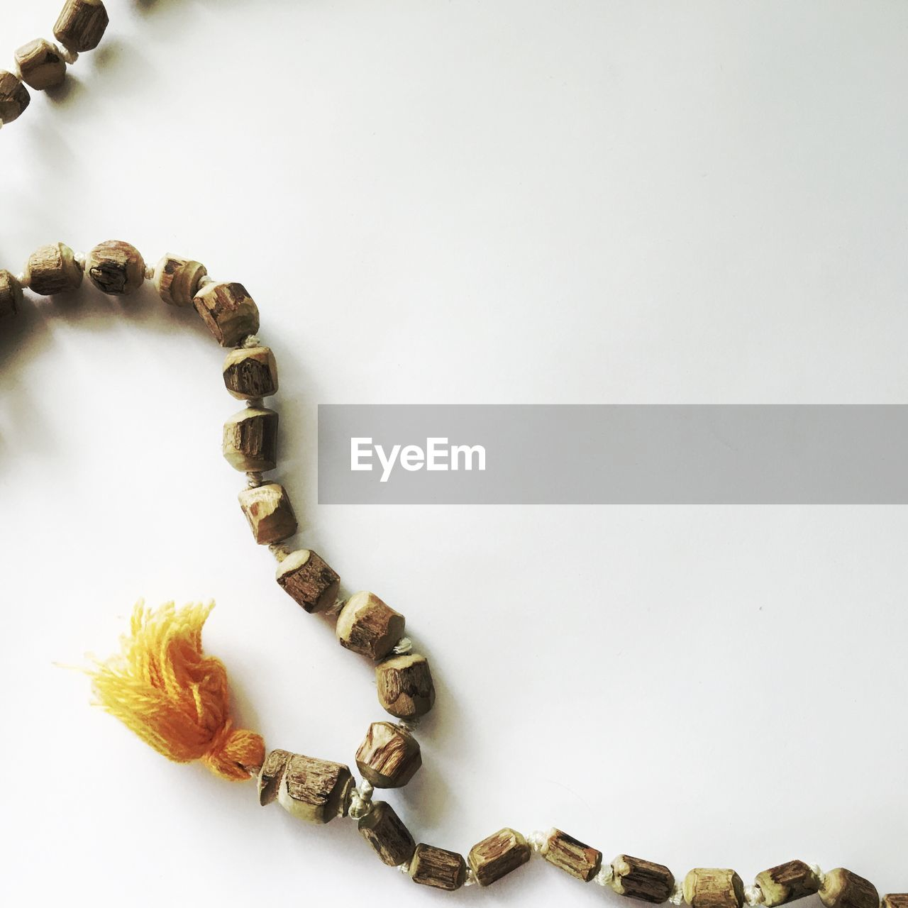 Close-up of necklace on white background