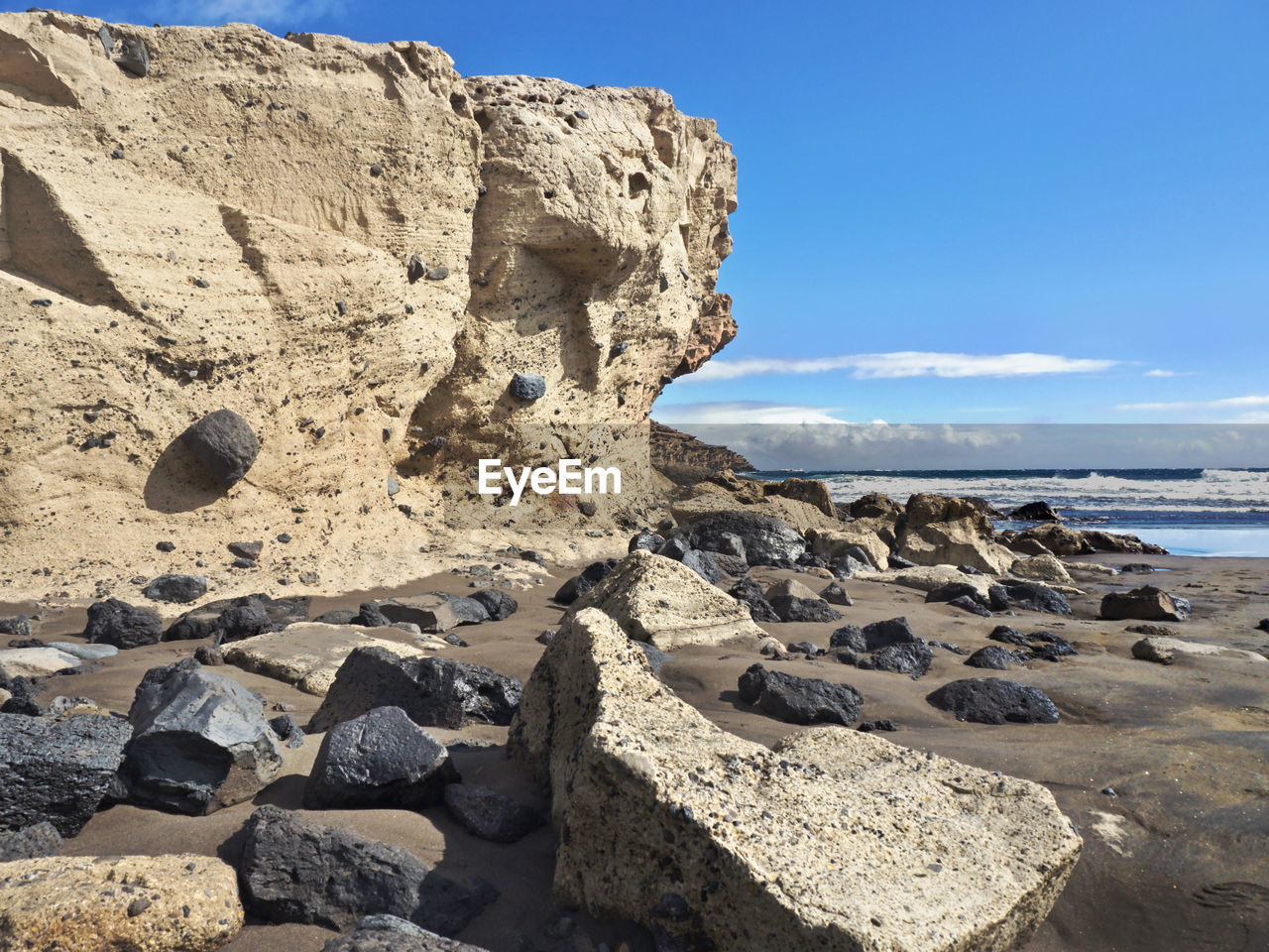 sky, solid, rock, land, sea, rock - object, water, beach, nature, sunlight, beauty in nature, scenics - nature, rock formation, day, tranquility, tranquil scene, no people, non-urban scene, outdoors, eroded