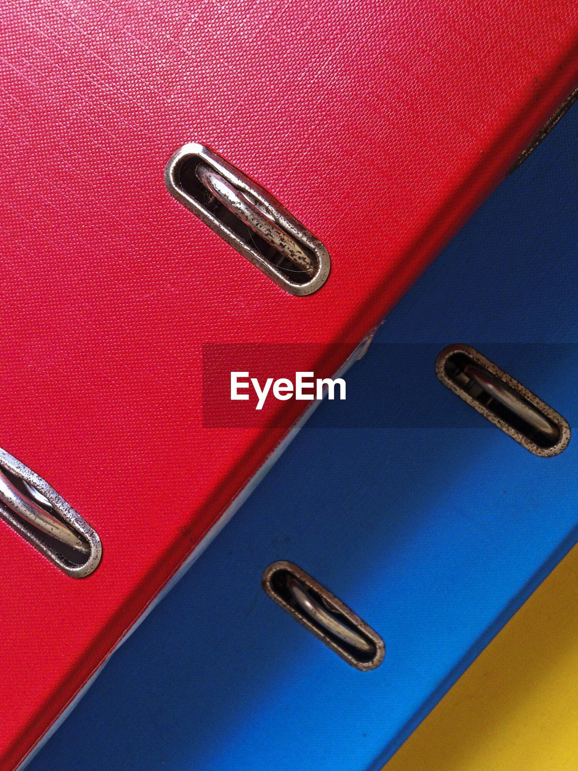 High angle view of red and blue ring binders