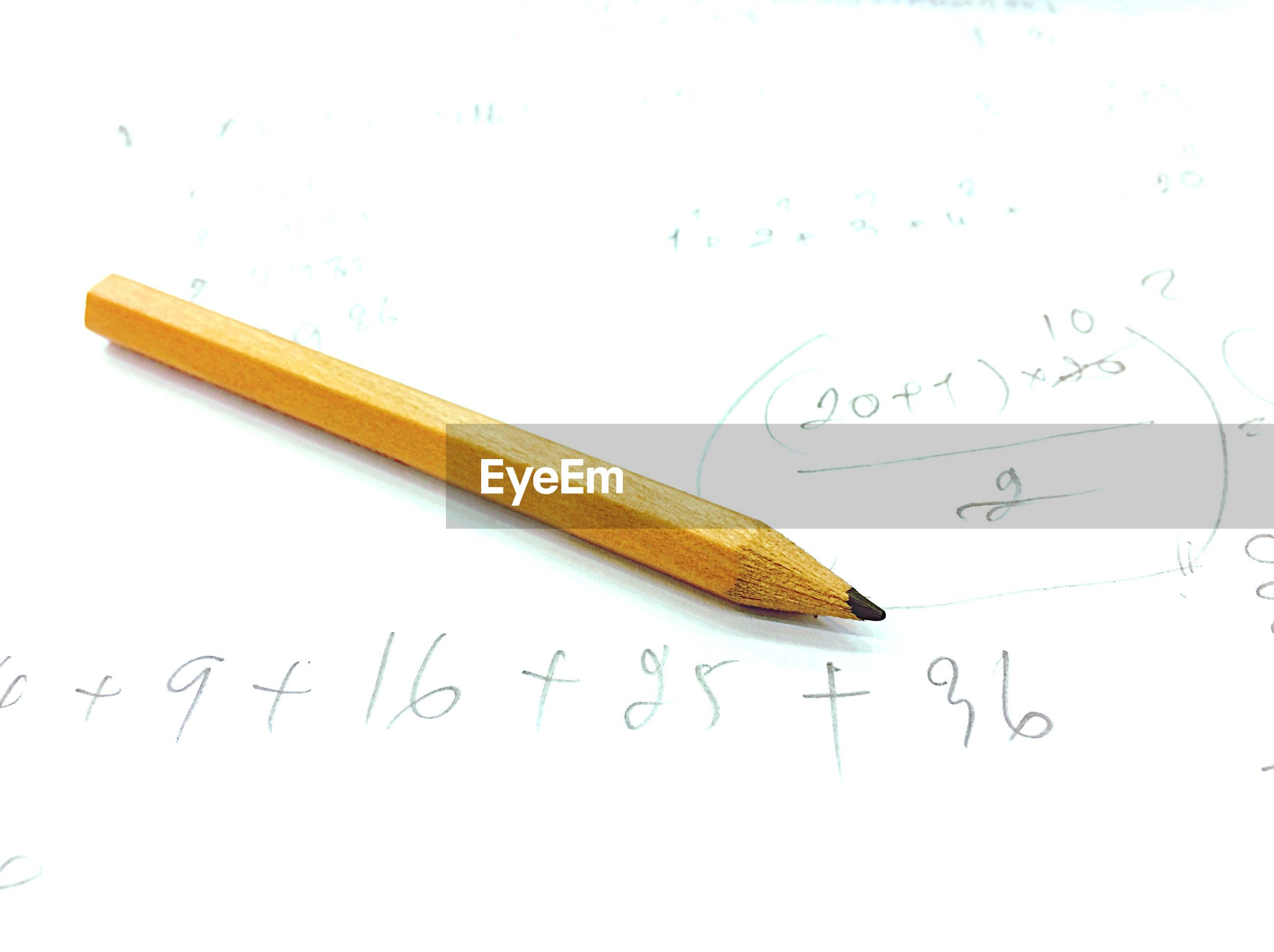 High angle view of pencil and book with numbers