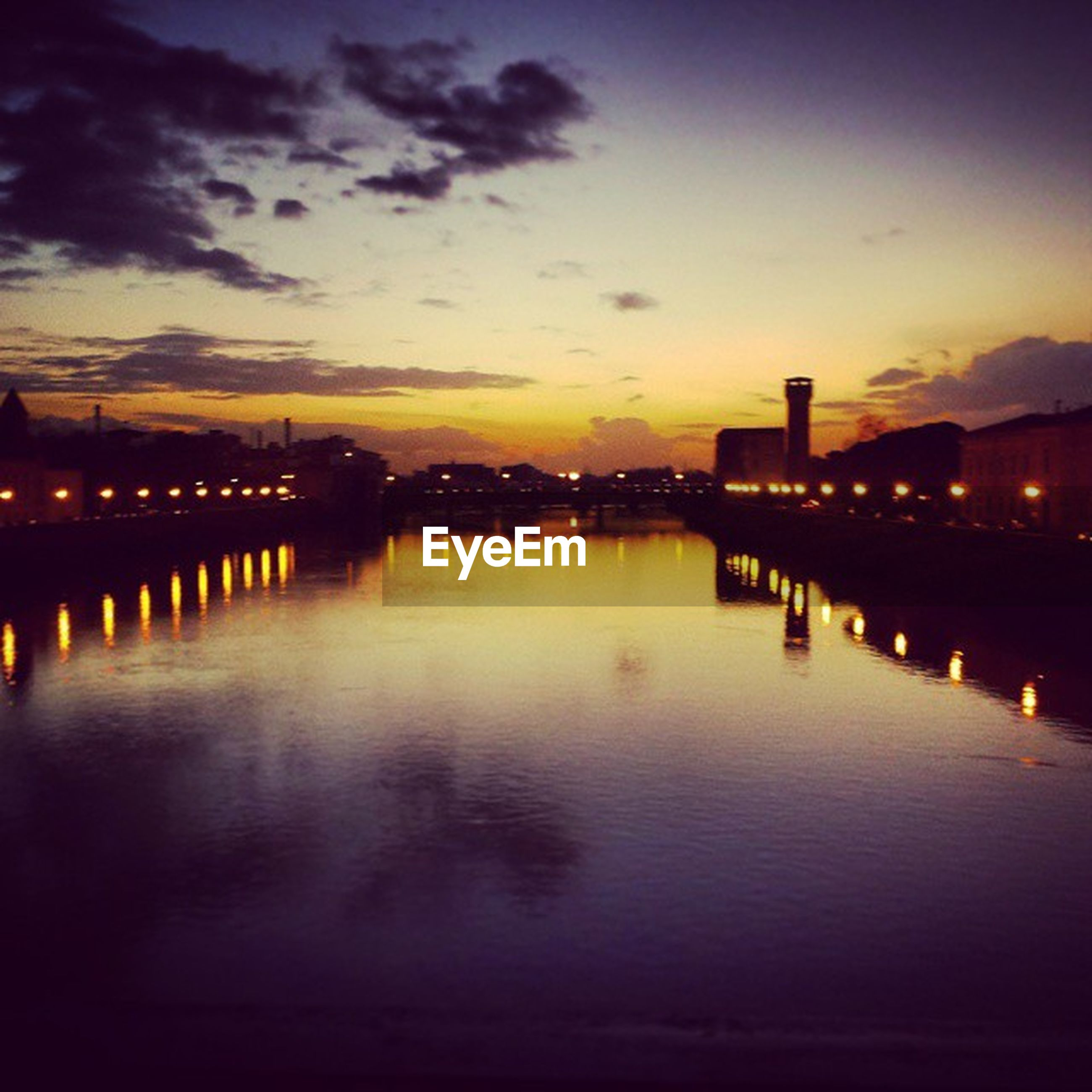 illuminated, water, sunset, reflection, built structure, architecture, night, sky, river, waterfront, silhouette, dusk, pier, connection, bridge - man made structure, building exterior, sea, city, street light, scenics