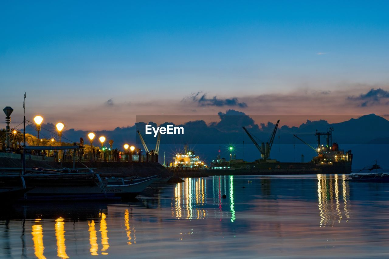 water, illuminated, sky, nautical vessel, transportation, reflection, mode of transportation, waterfront, nature, cloud - sky, no people, sunset, sea, harbor, pier, machinery, industry, architecture, crane - construction machinery