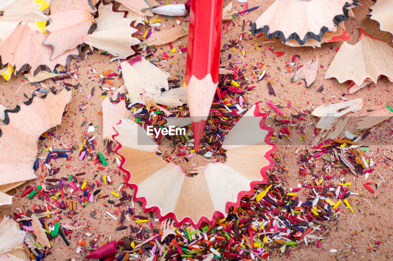 multi colored, high angle view, day, messy, celebration, large group of objects, confetti, close-up, no people, creativity, flooring, indoors, nature, paper, flower, abundance, body part, chaos