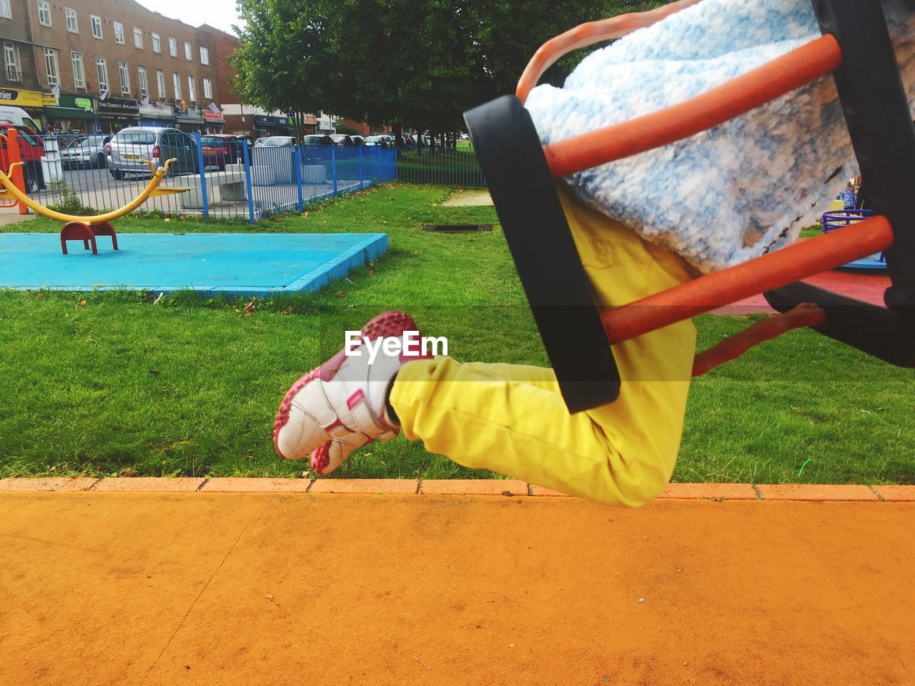 BOY PLAYING ON SLIDE AT PARK