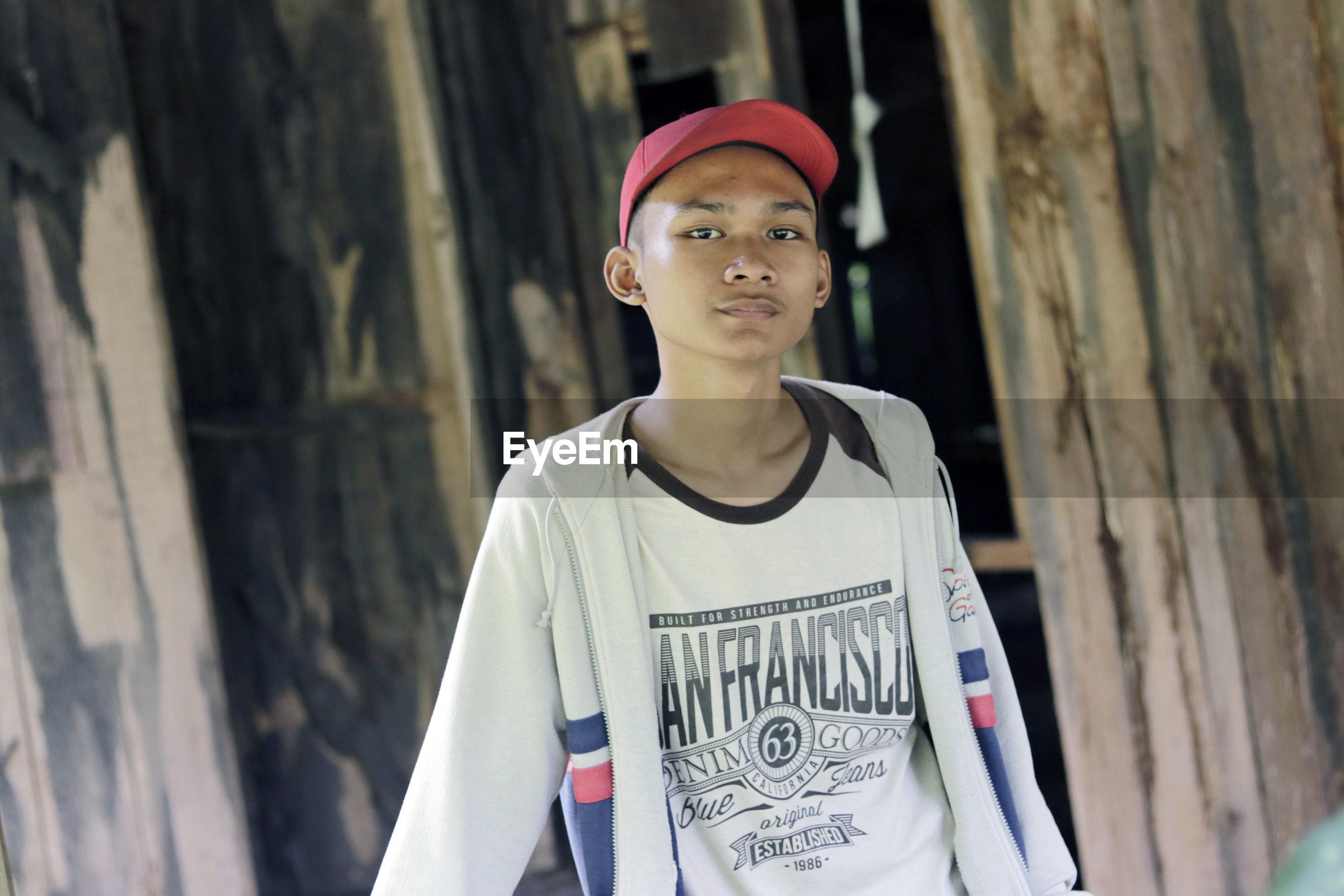 Portrait of boy wearing cap