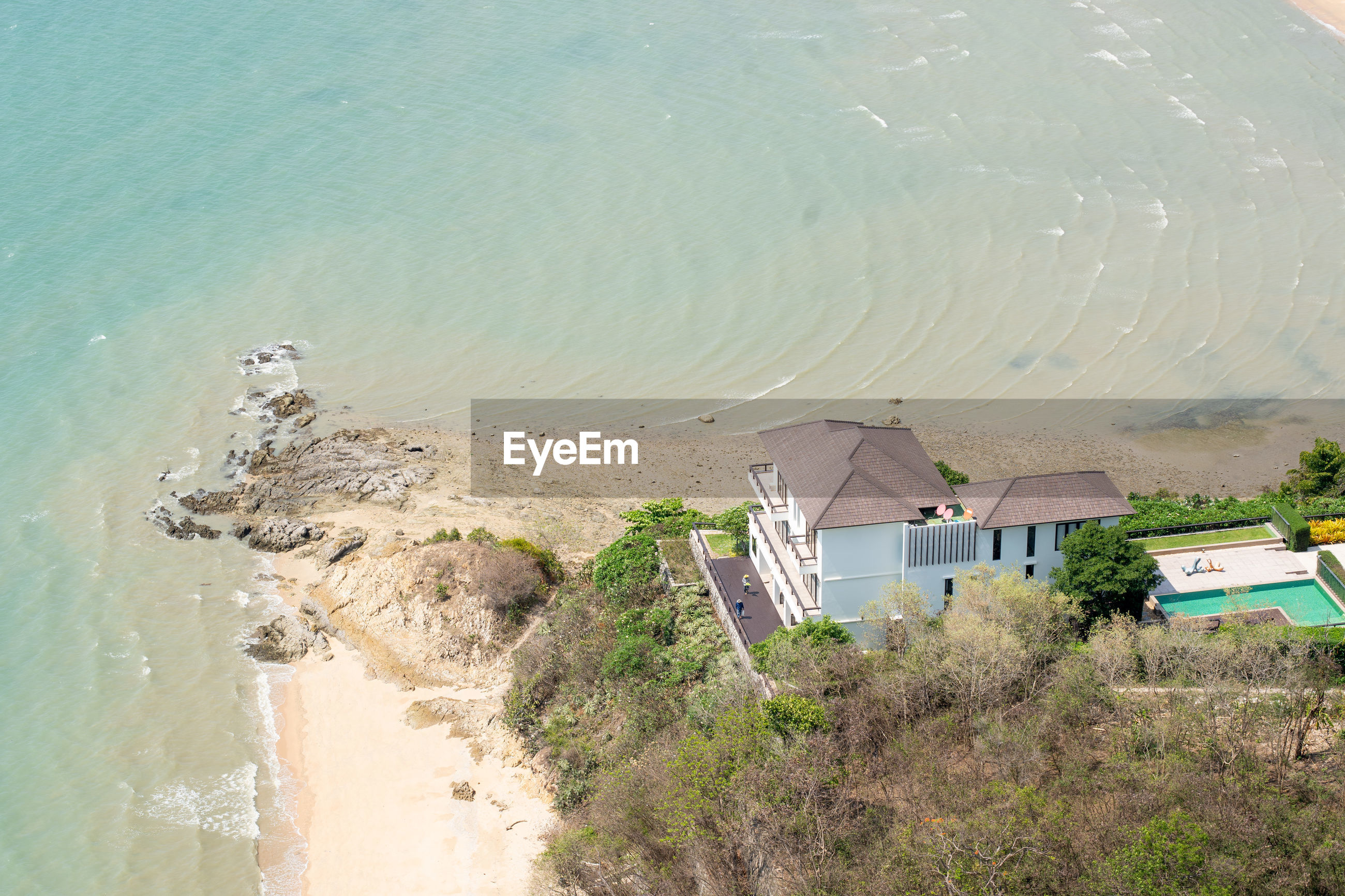 HIGH ANGLE VIEW OF BEACH AND BUILDINGS