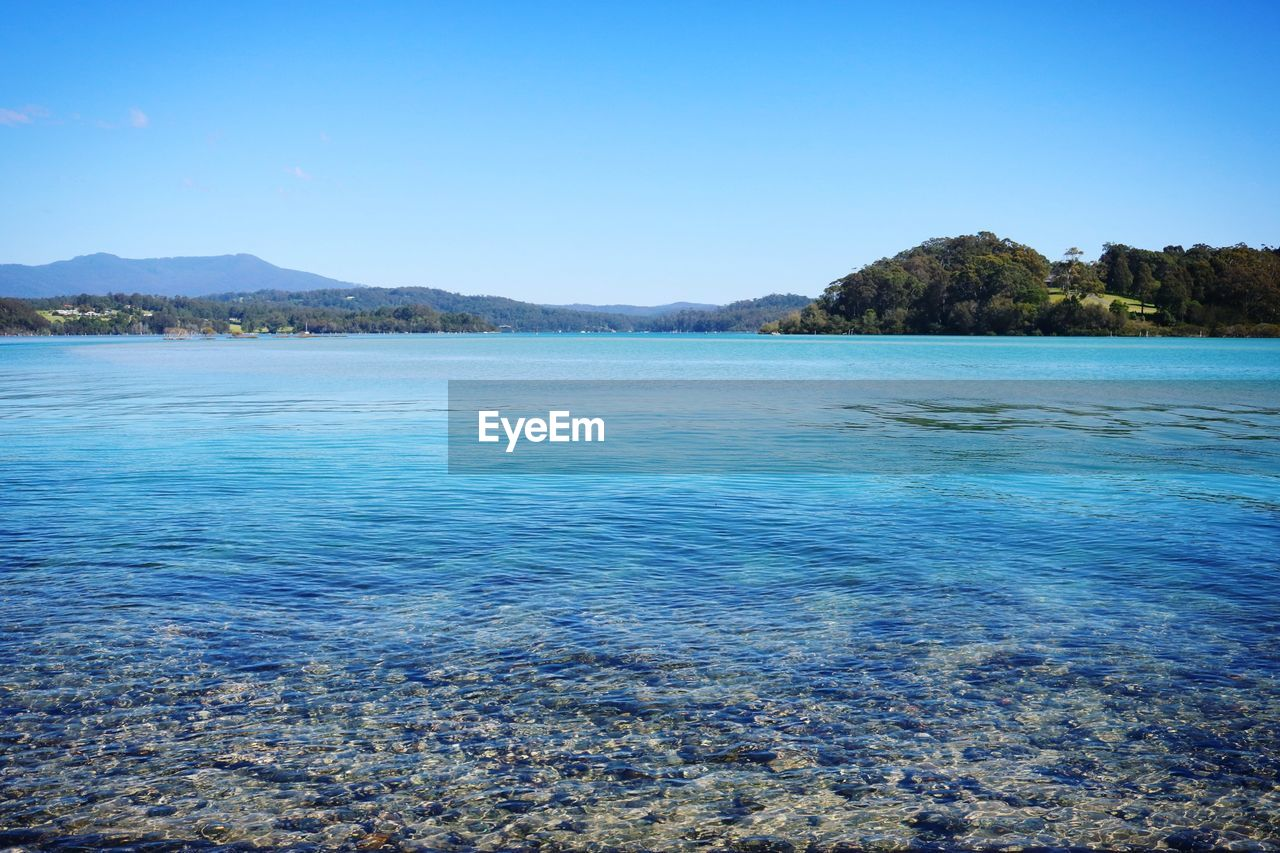 scenics, beauty in nature, tranquil scene, tranquility, nature, blue, mountain, outdoors, clear sky, day, no people, water, rippled, lake, landscape, sky, tree
