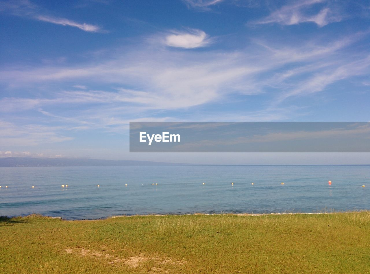 sea, sky, nature, water, beauty in nature, scenics, horizon over water, grass, no people, tranquility, tranquil scene, outdoors, cloud - sky, blue, day, landscape, beach