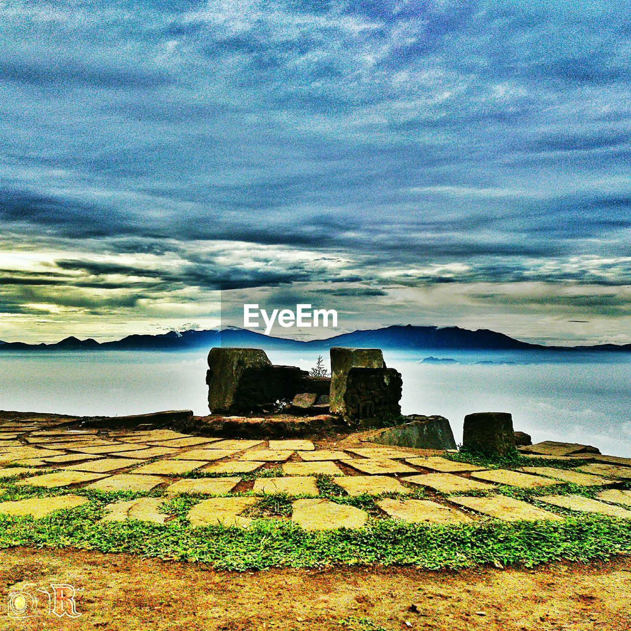 cloud - sky, sky, scenics, nature, sea, history, built structure, no people, rock - object, tranquility, landscape, old ruin, architecture, tranquil scene, beauty in nature, grass, water, day, travel destinations, outdoors, horizon over water, ancient civilization
