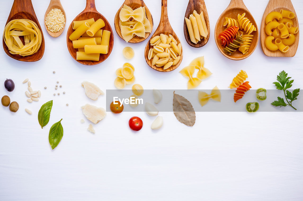 food and drink, food, still life, indoors, freshness, high angle view, white background, choice, table, variation, large group of objects, studio shot, no people, arrangement, directly above, sweet food, healthy eating, indulgence, multi colored, fruit, temptation, order, snack