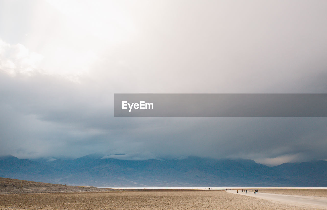 Scenic View Of Desert Against Cloudy Sky At Death Valley National Park