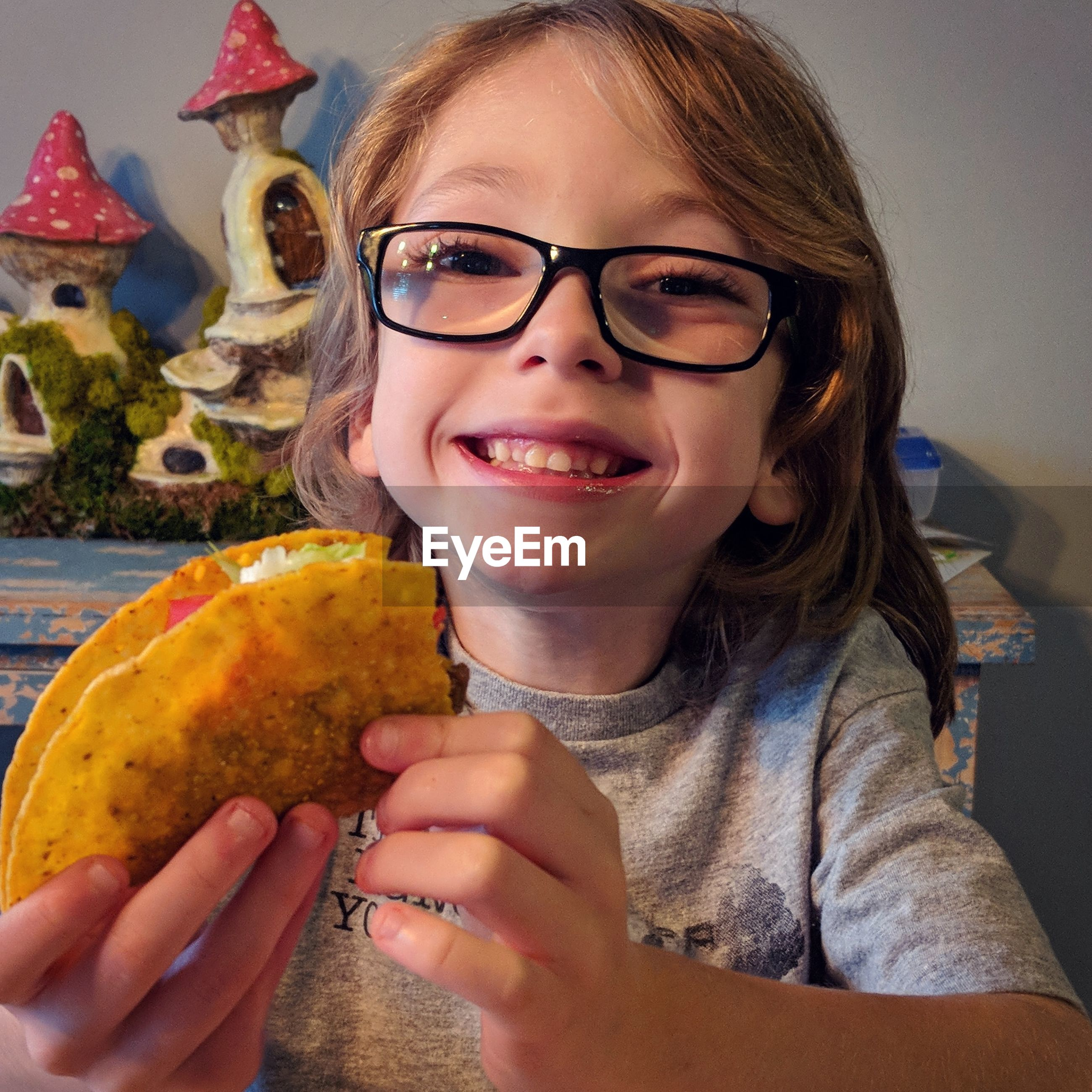 Portrait of smiling girl holding taco